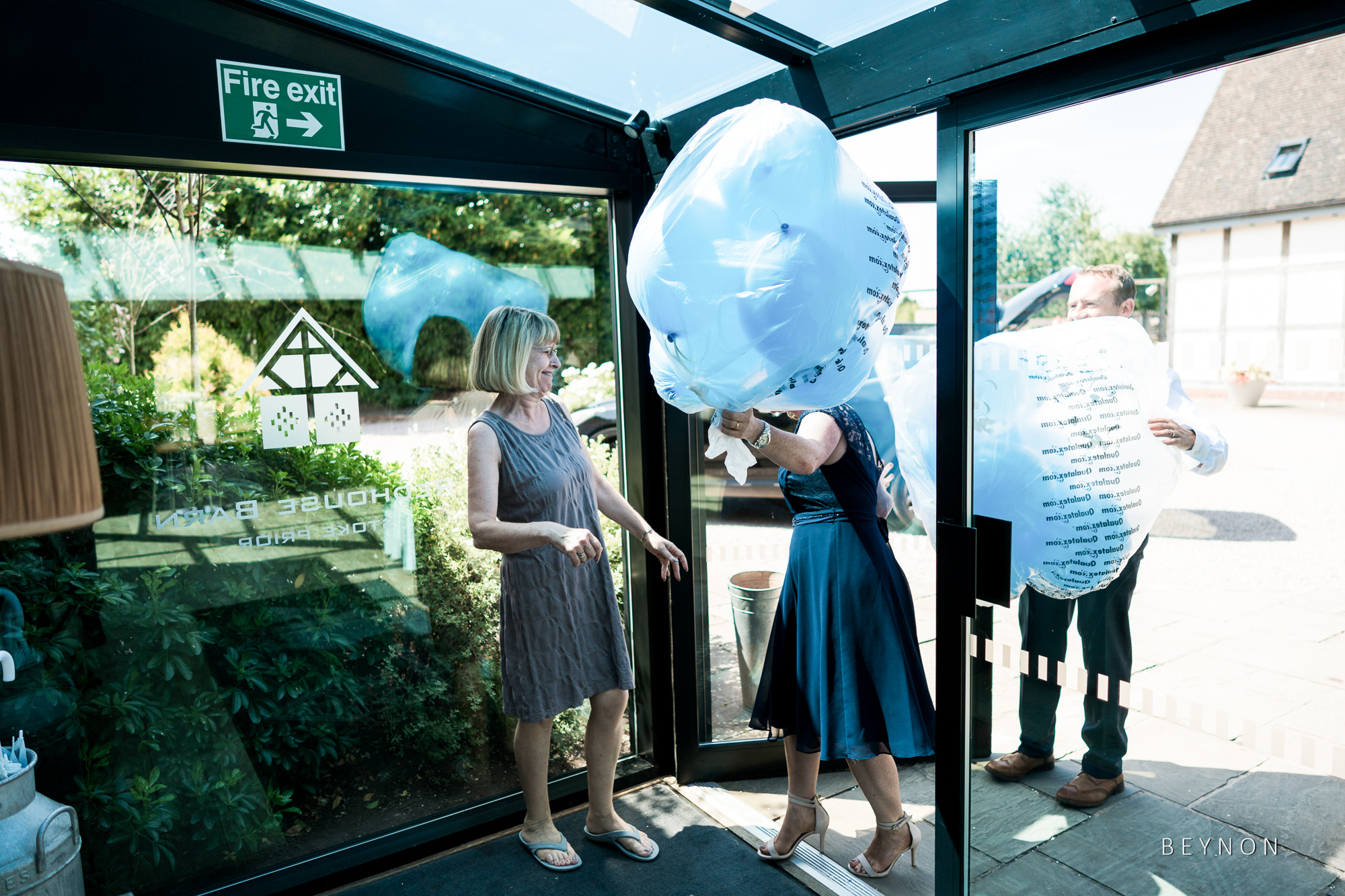 Guests arrive with balloons