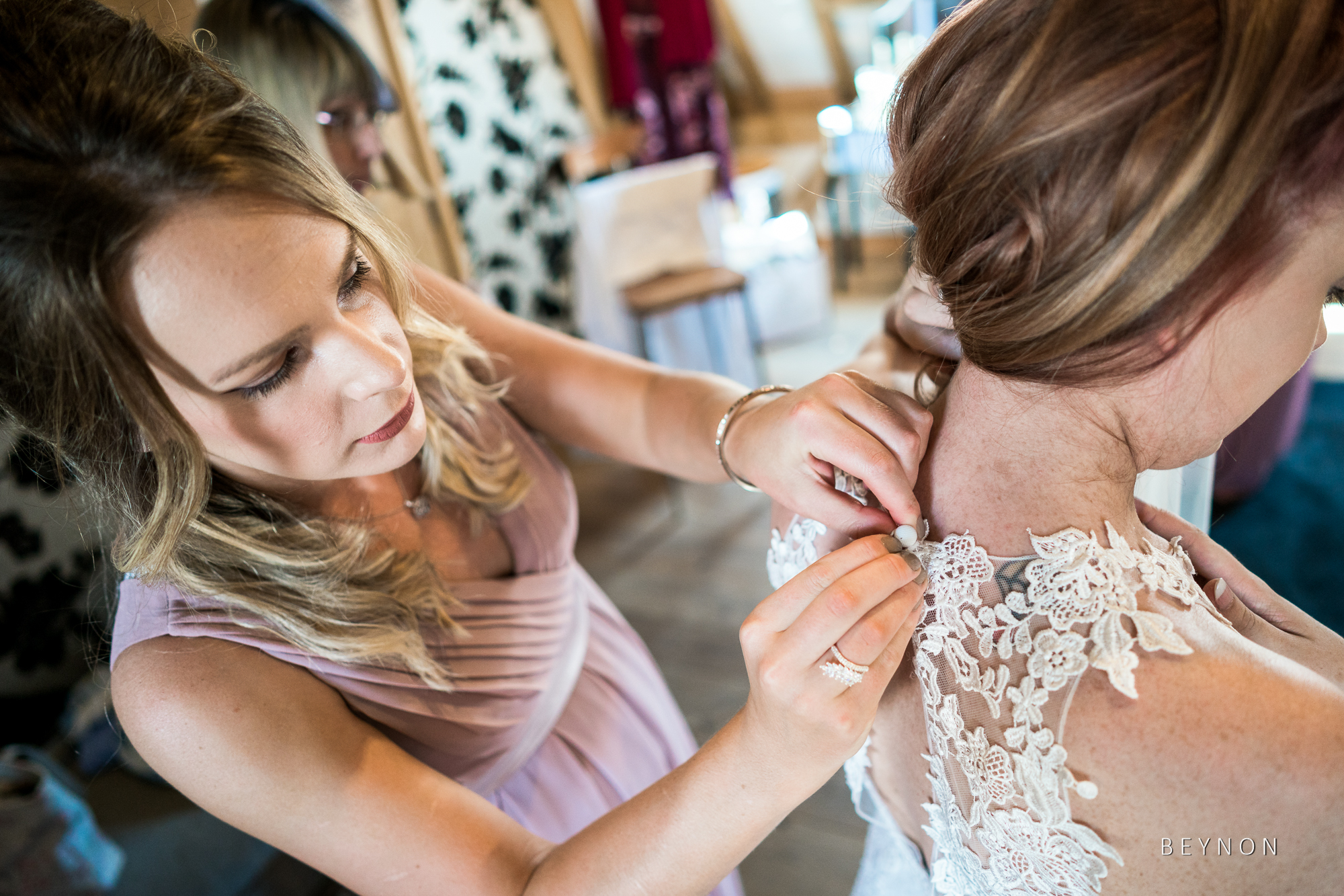 Bridesmaid does up wedding dress