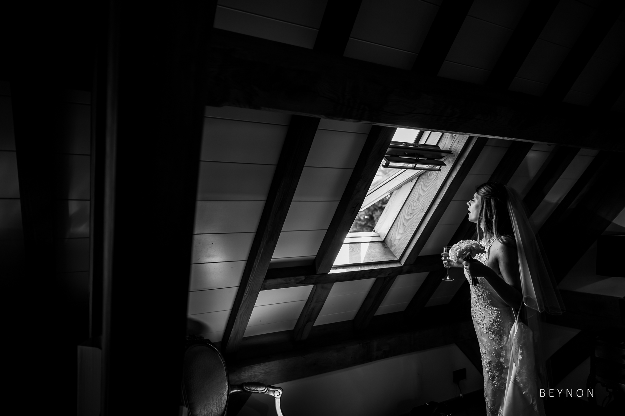 Bride looks out of window