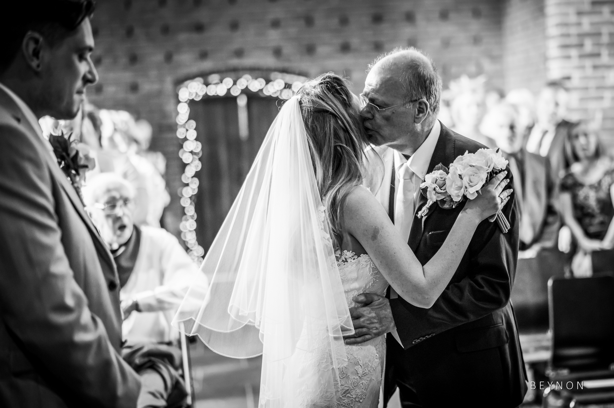 Dad kisses his daughter