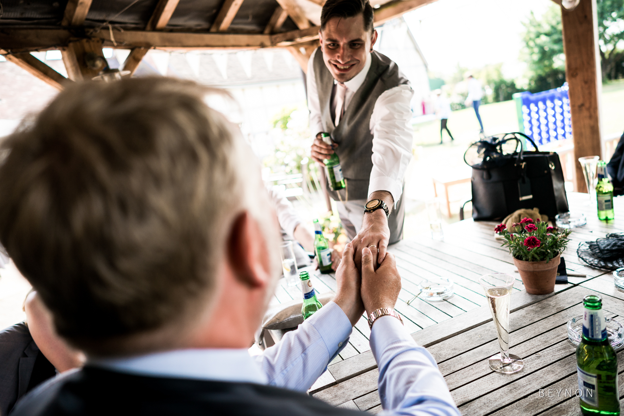 Guest looks at Groom's wedding ring