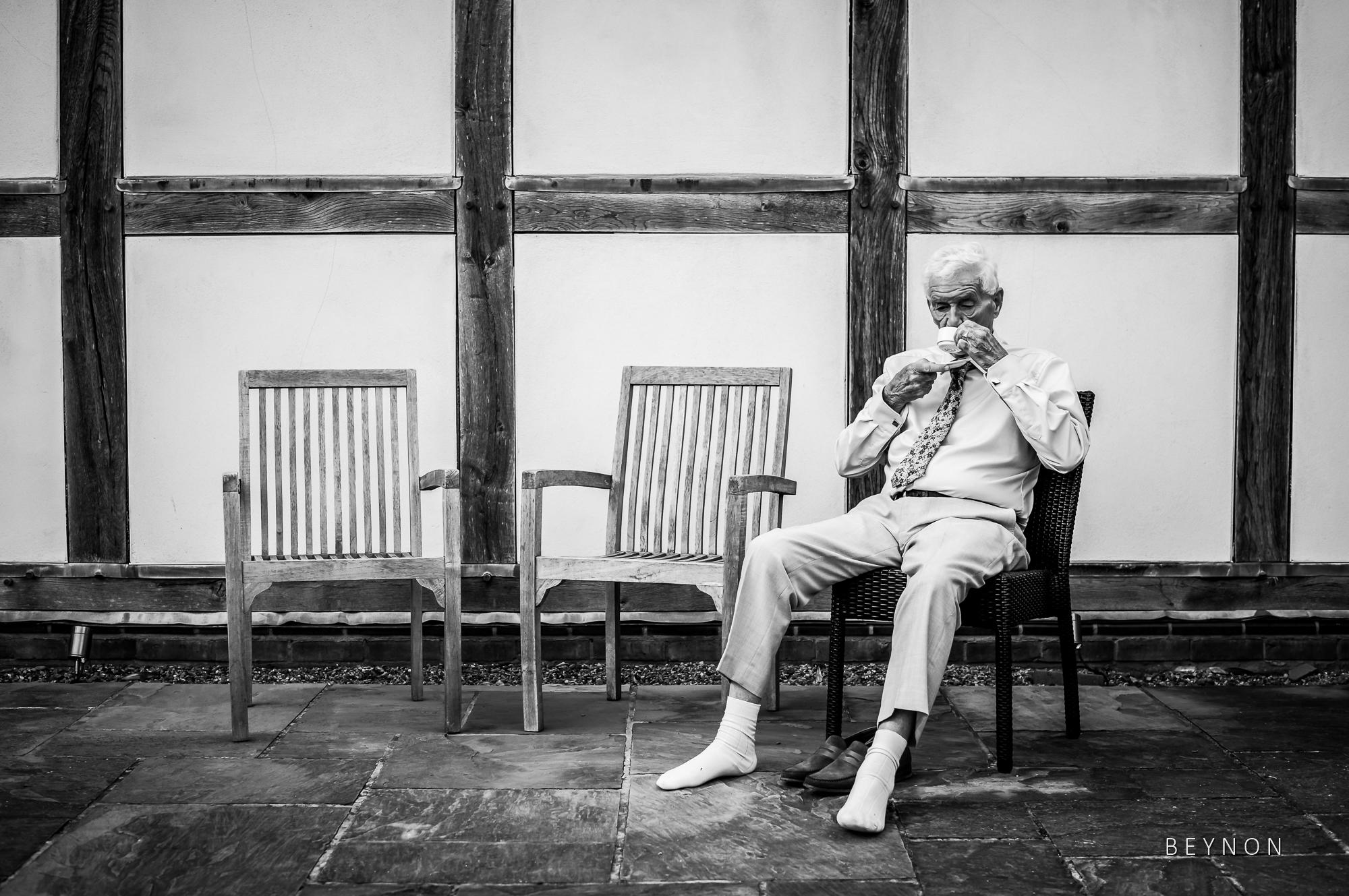Elderly guest drinks tea