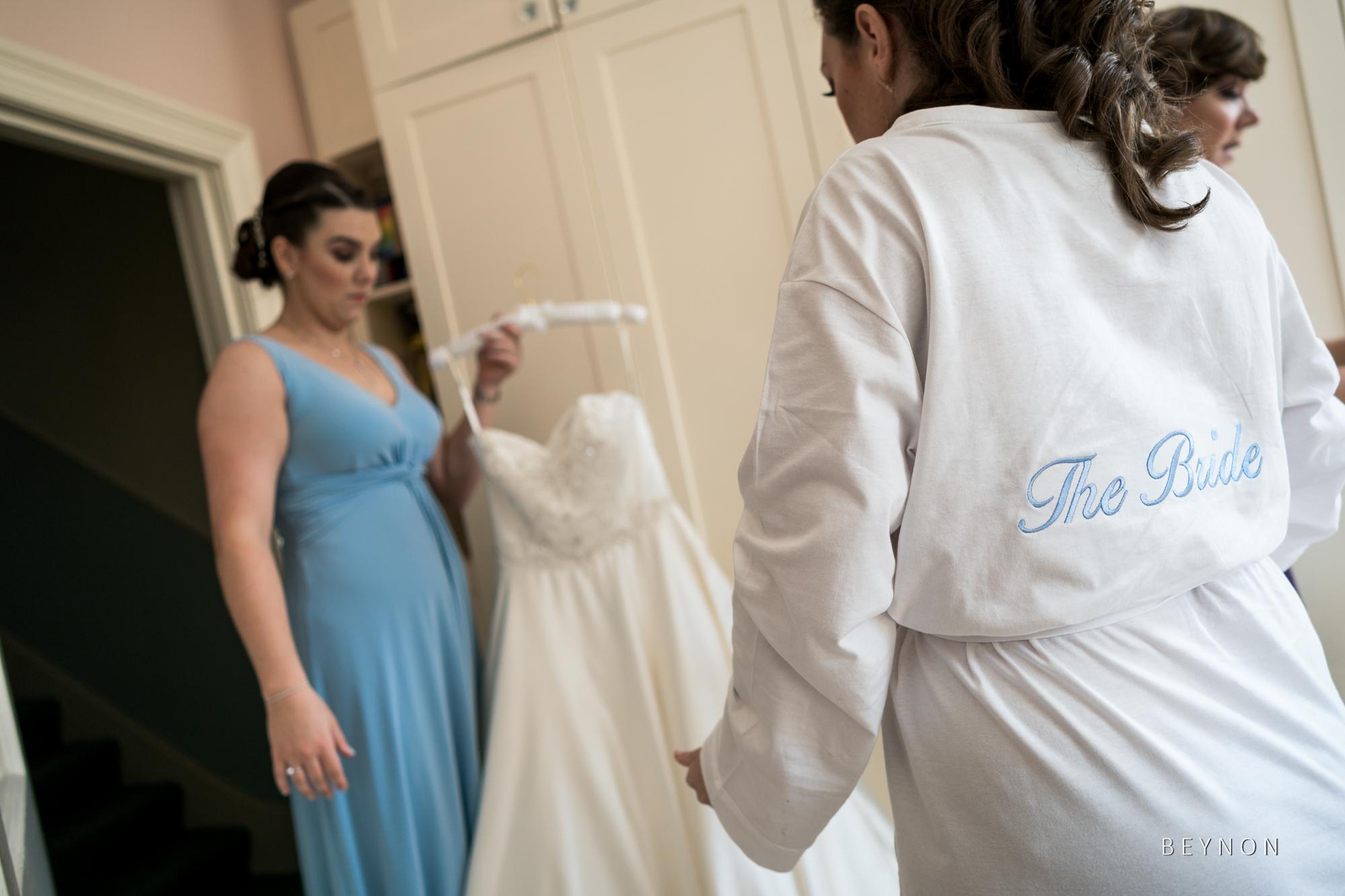 Bridesmaid helps bride
