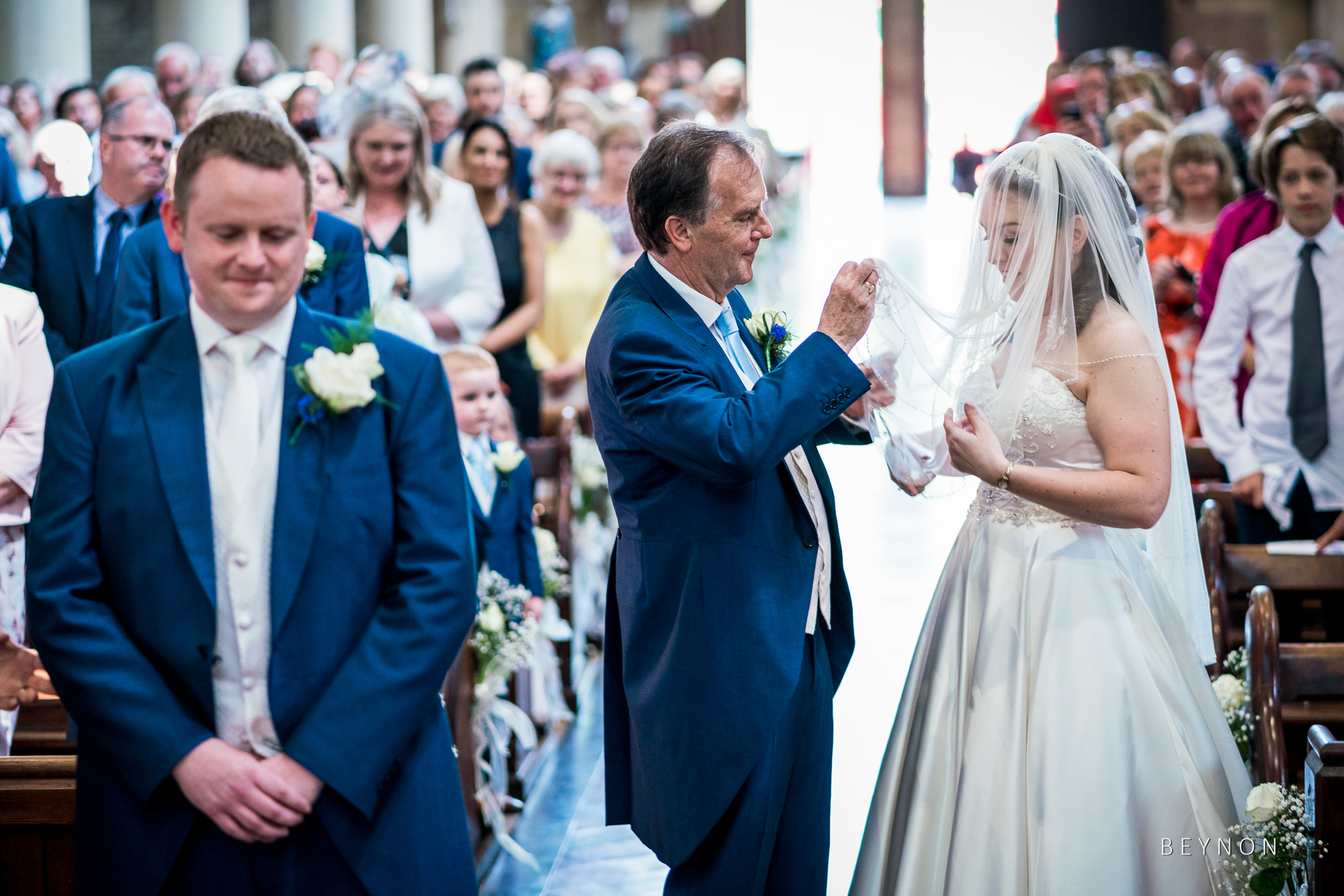 Dad lifts bride's veil