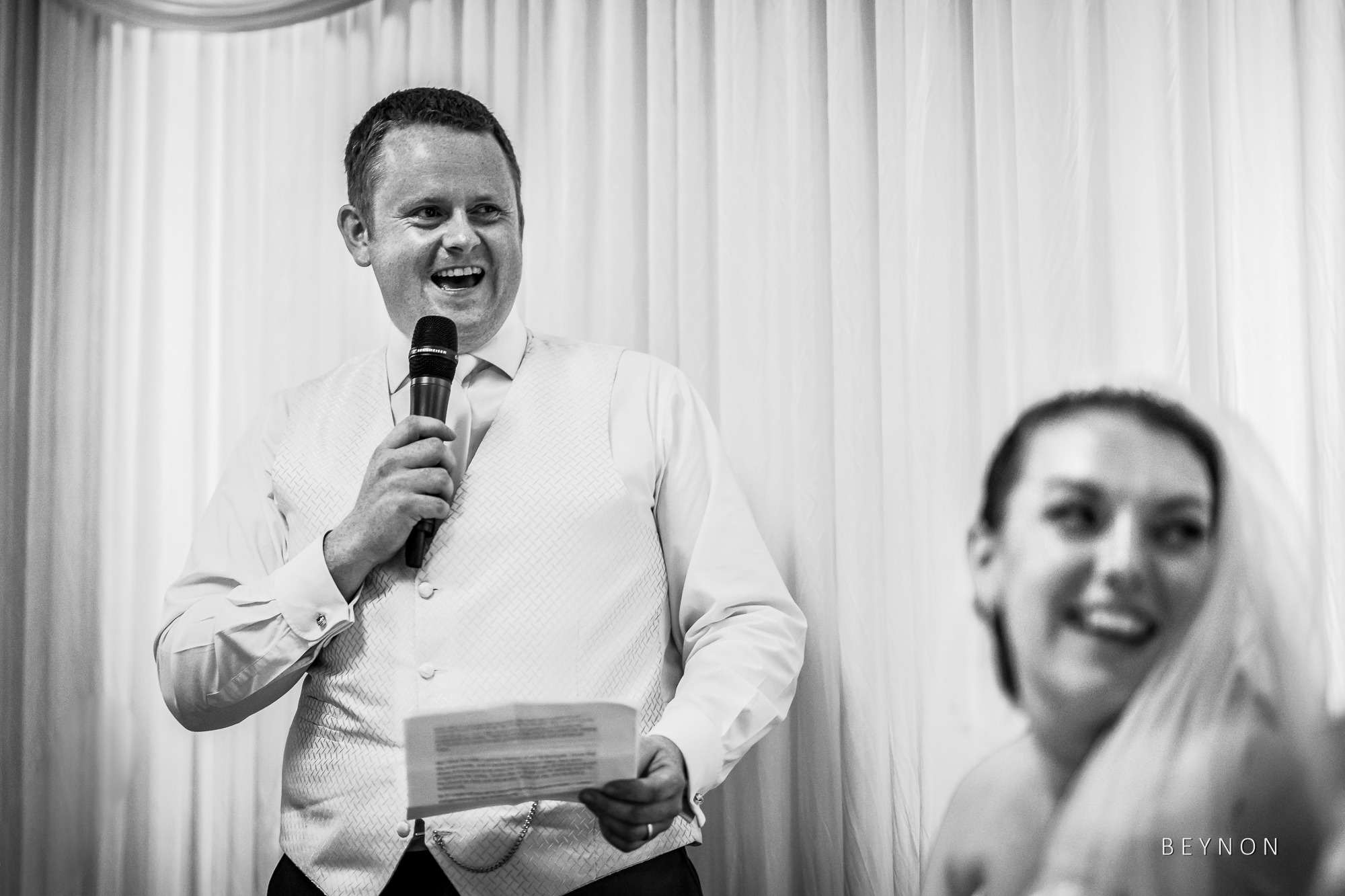 Groom's speech makes bride smile