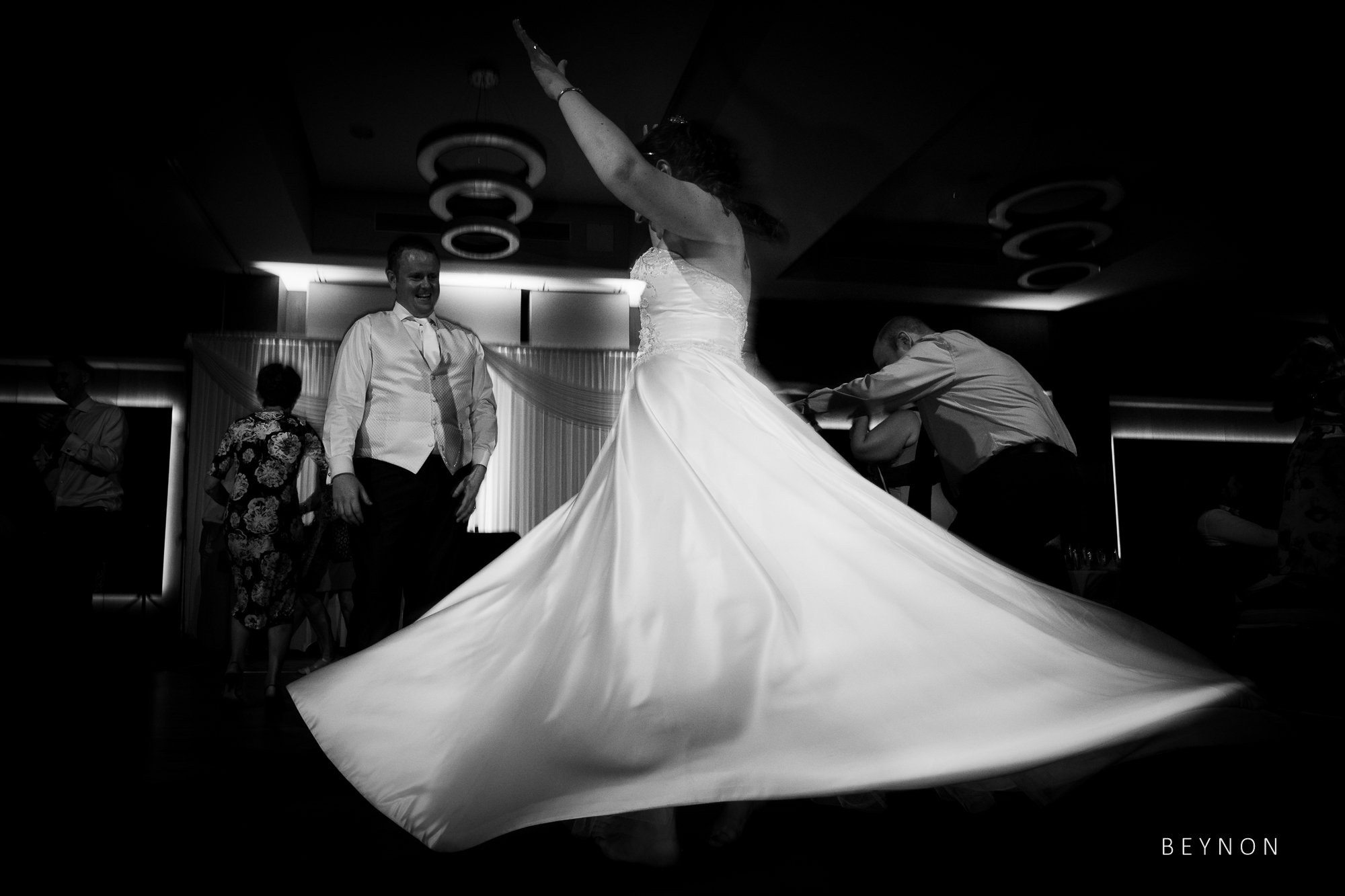 Bride twirls her dress