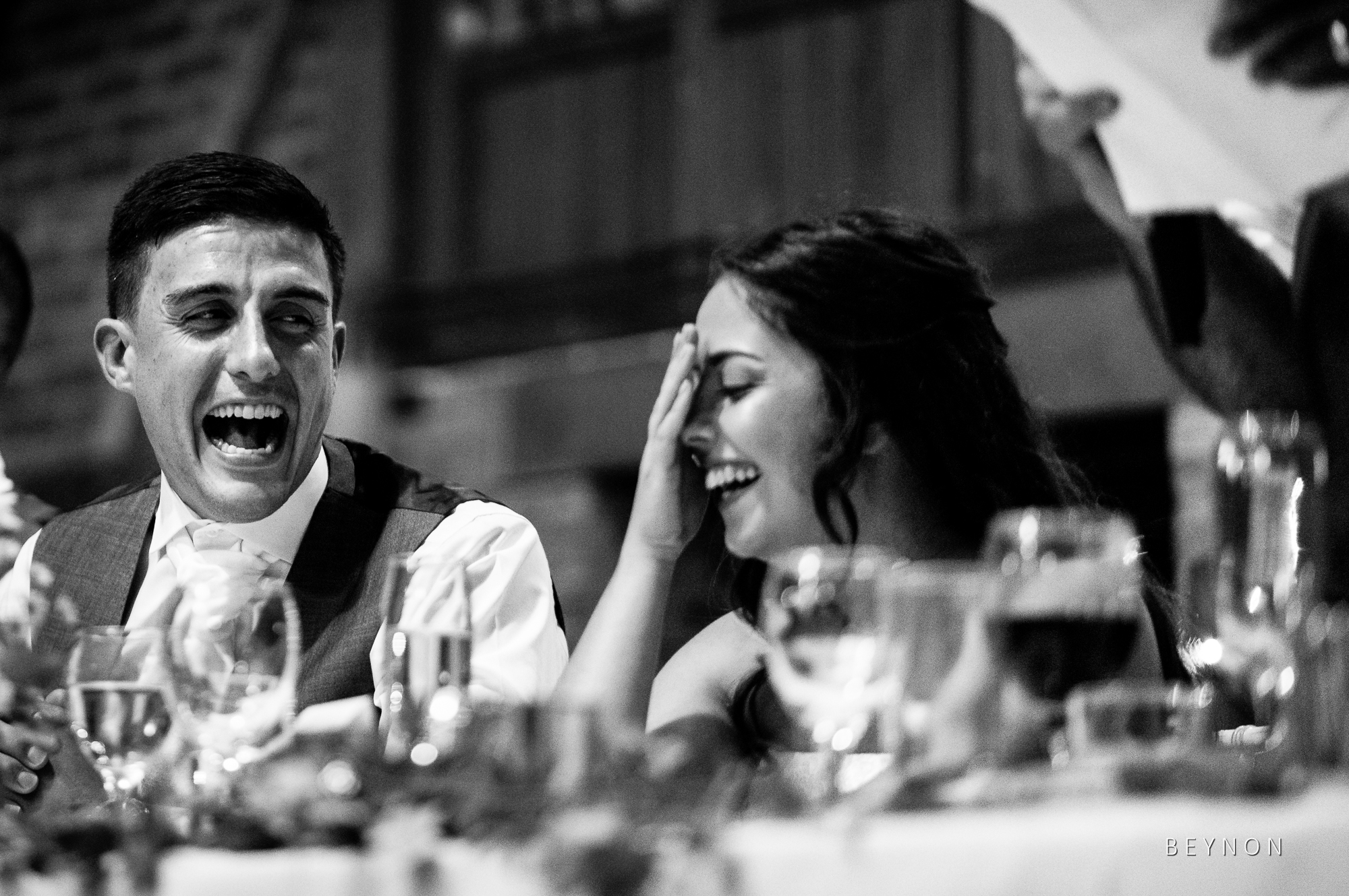 Black and White photograph of bride laughing