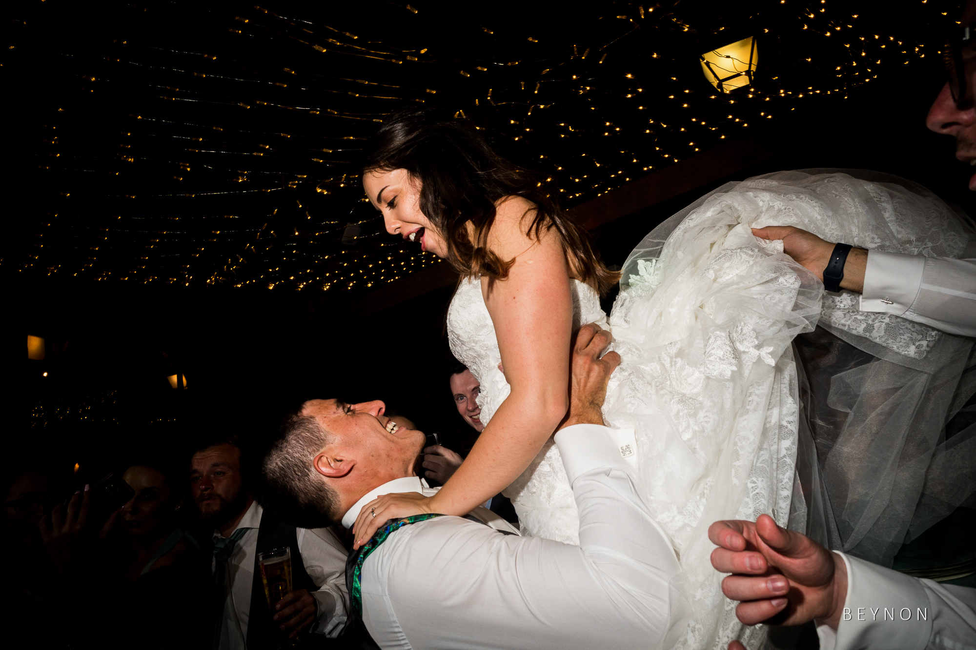 Groom lifts up bride