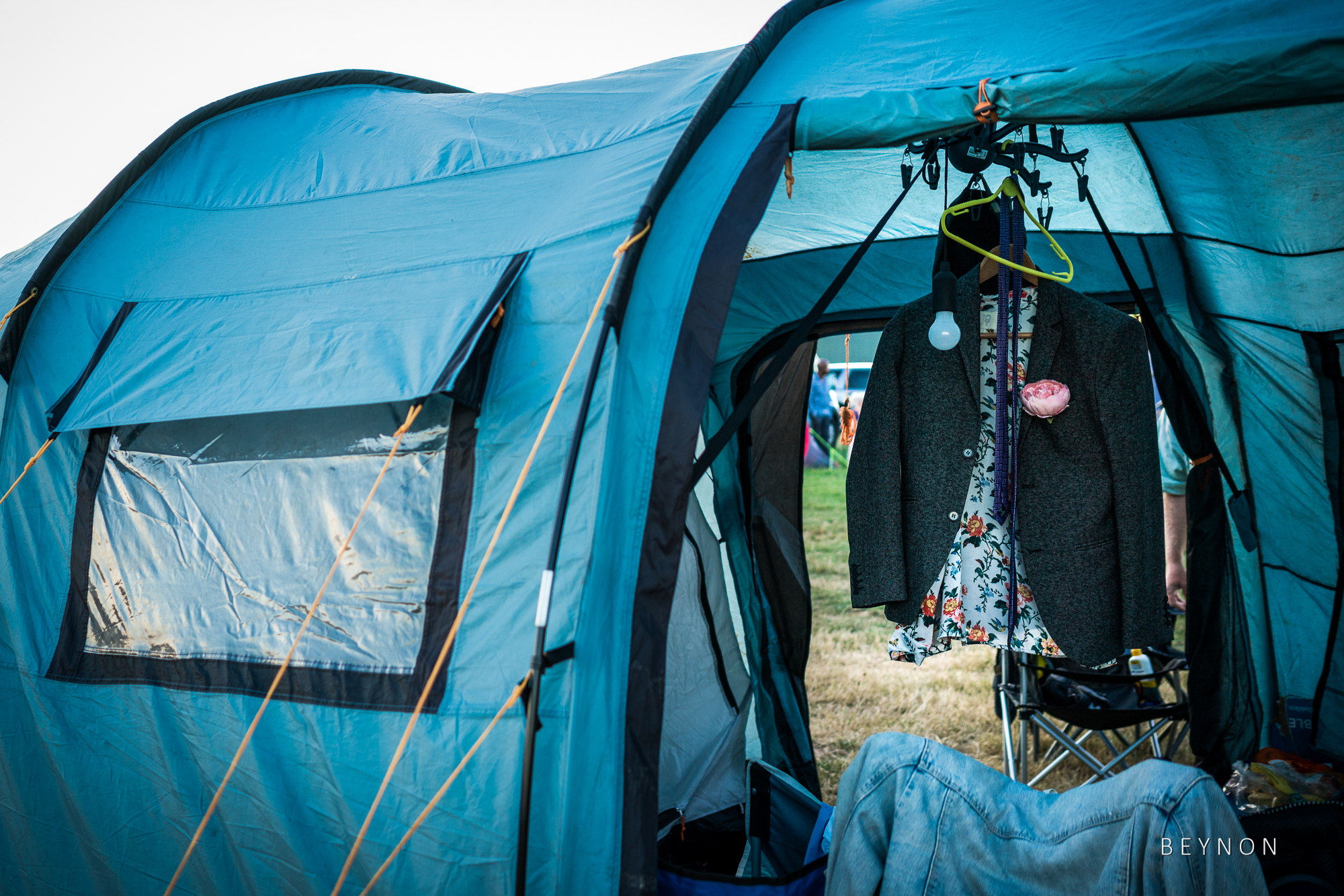 Wedding suit hanging up inside tent