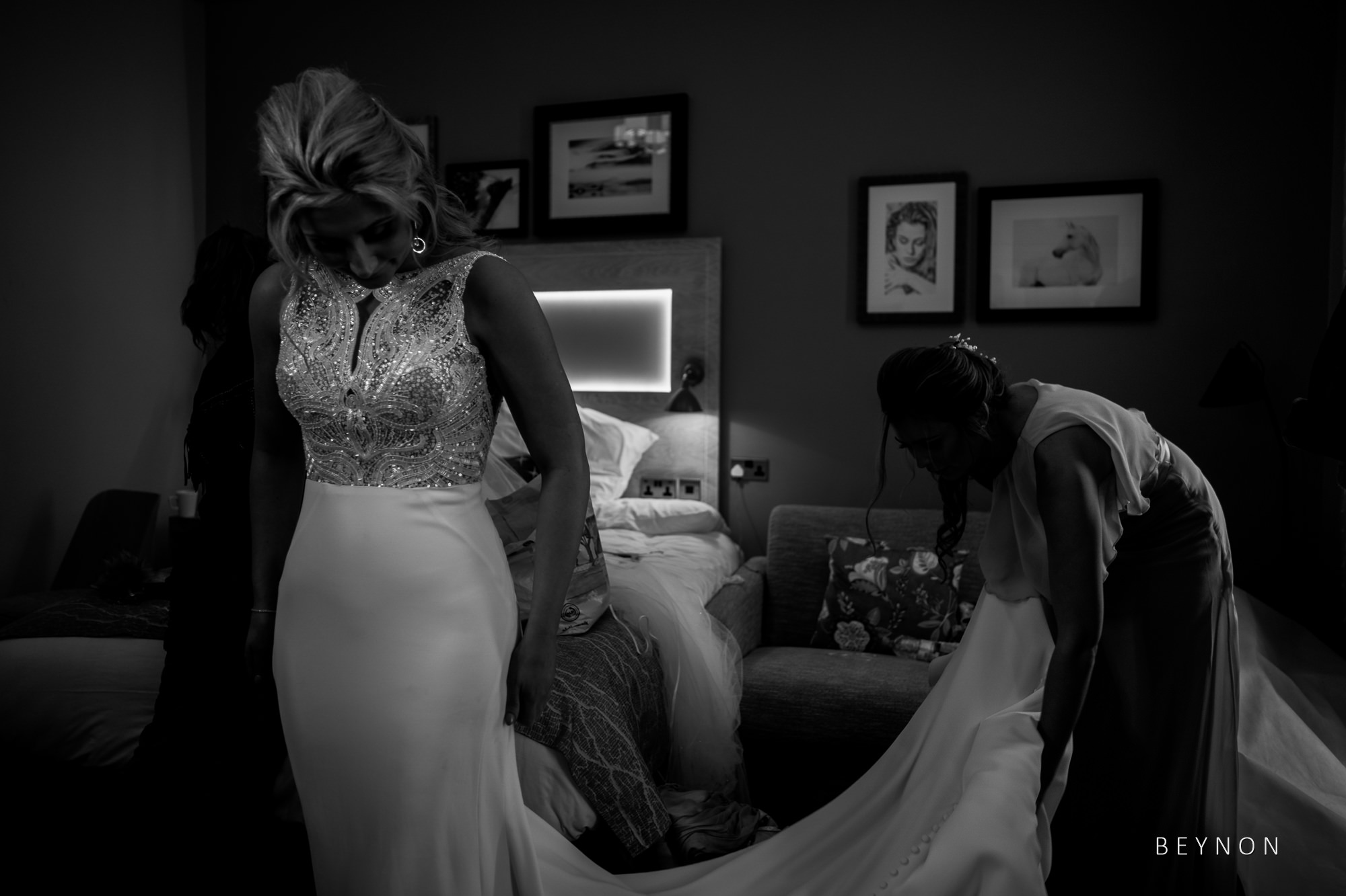 Bride checks herself out in her dress