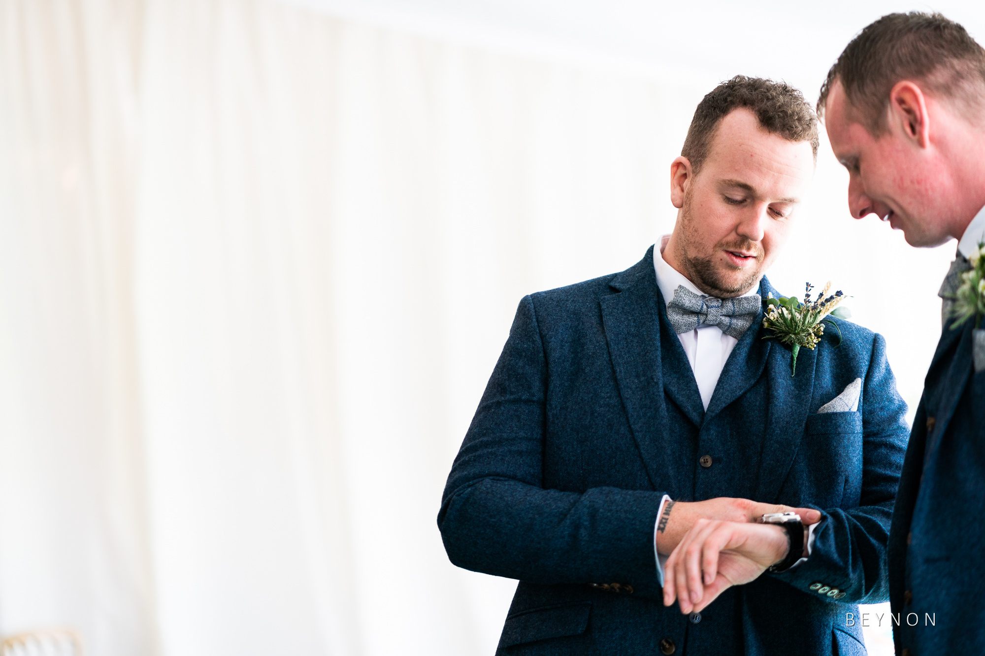 Groom checks watch