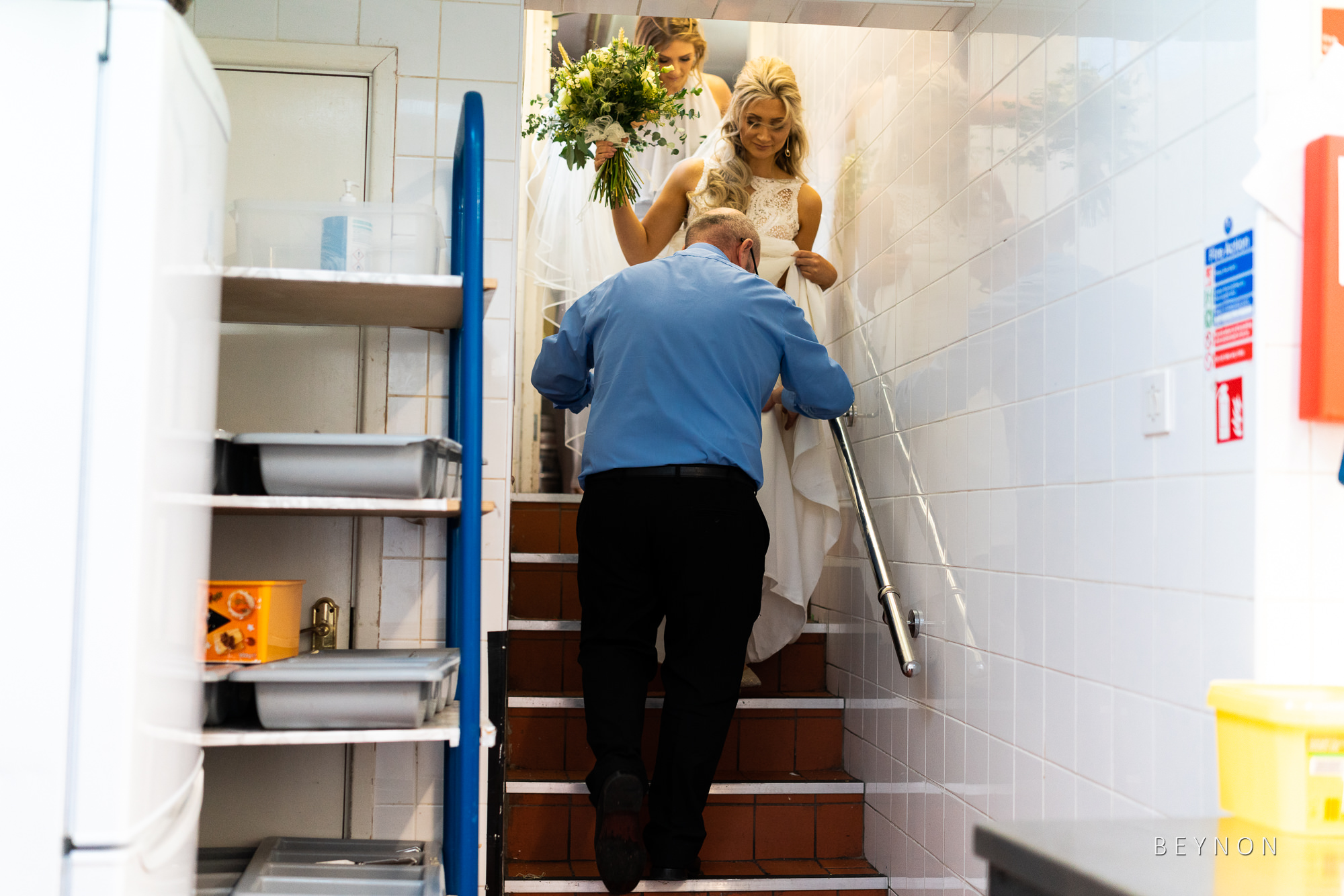 Bride is guided through kitchens