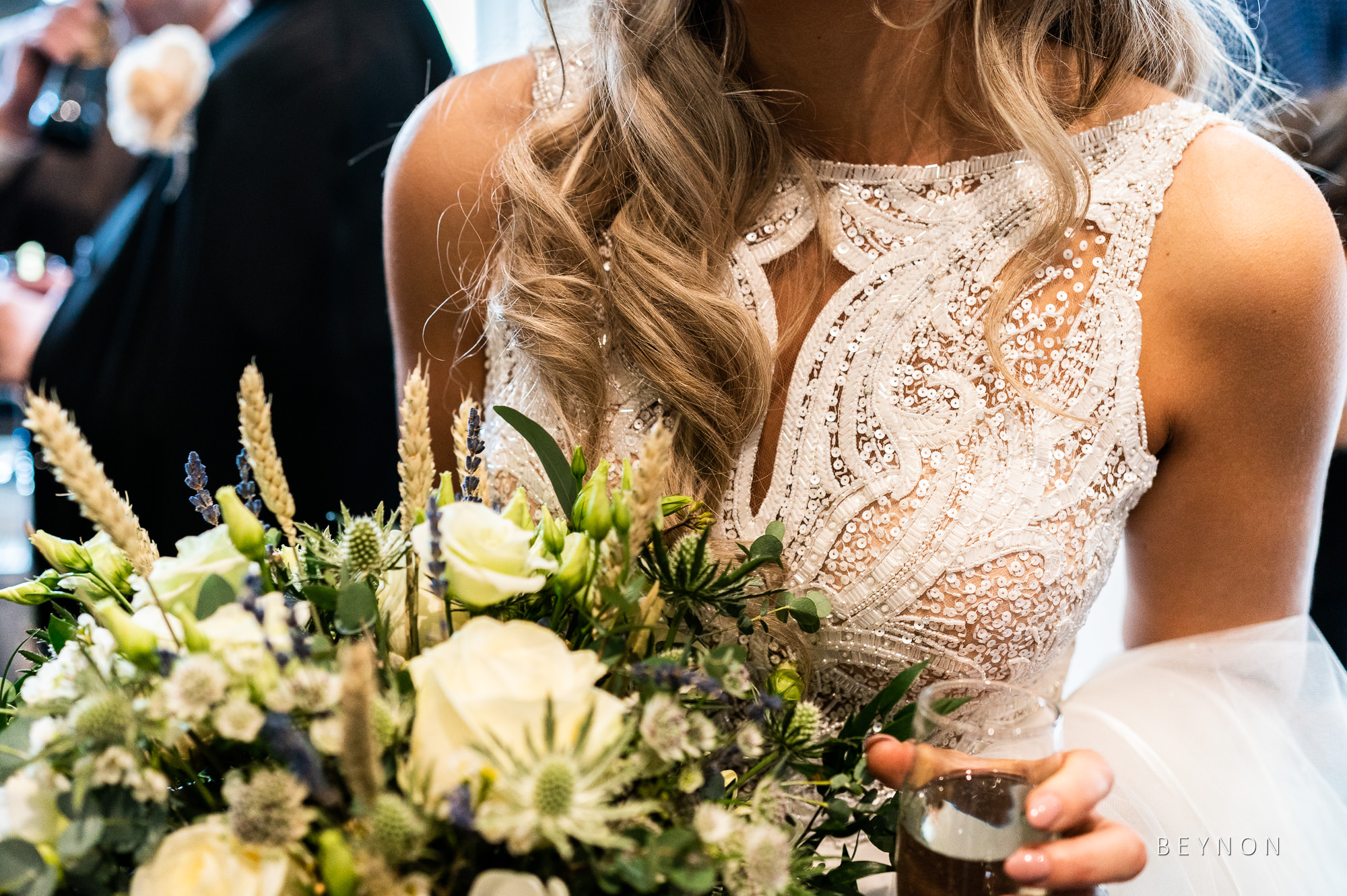 Details shot of the brides dress