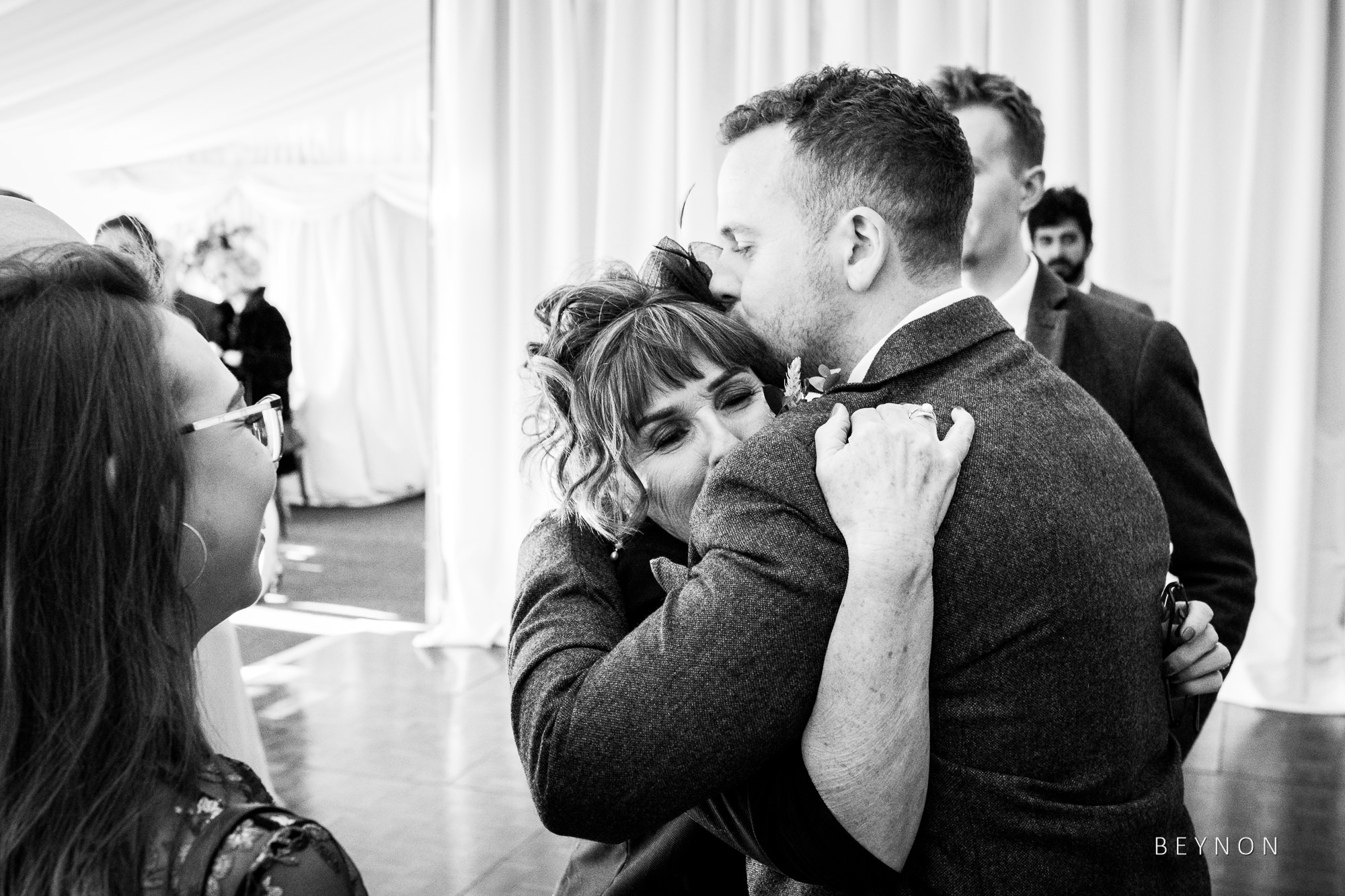 Mum hugs the groom