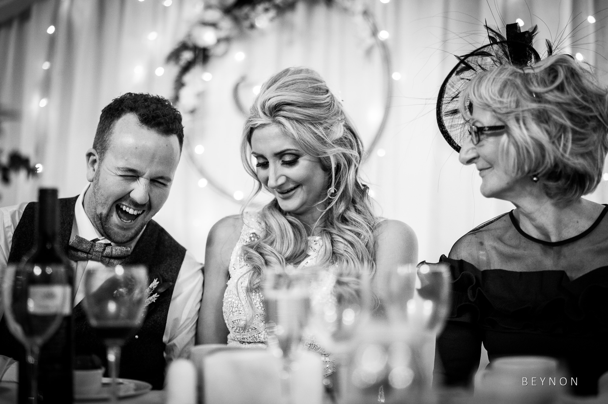 Groom laughs at joke