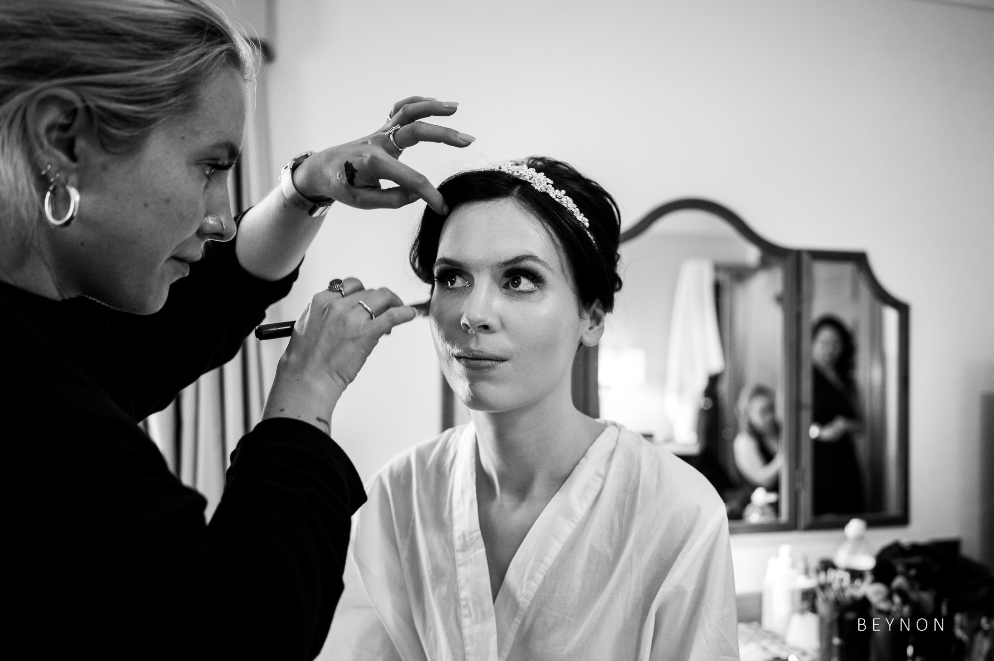 Bride has make-up done