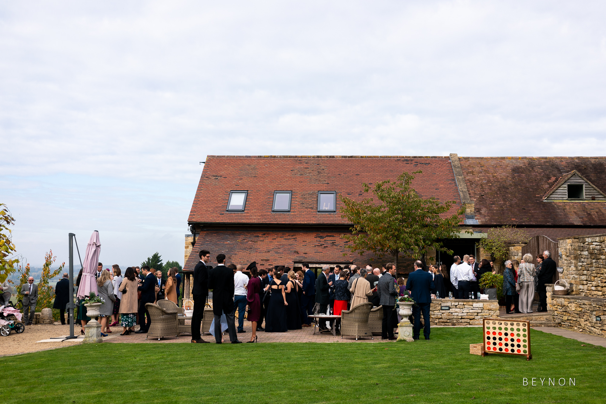 Guests gather in the ground