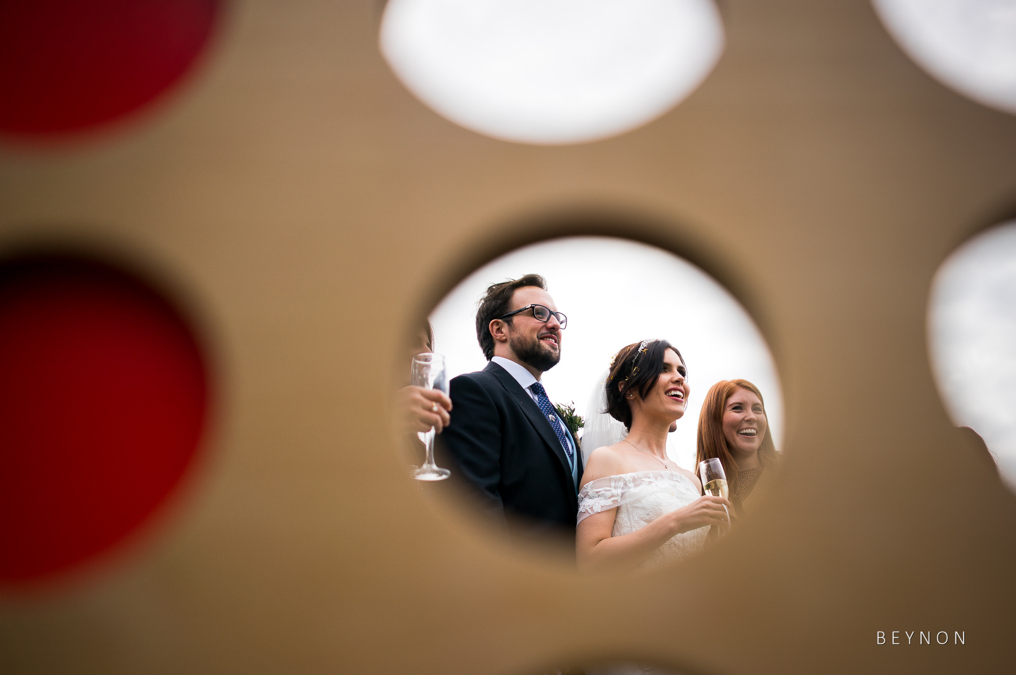 Creative candid photograph of bride and groom