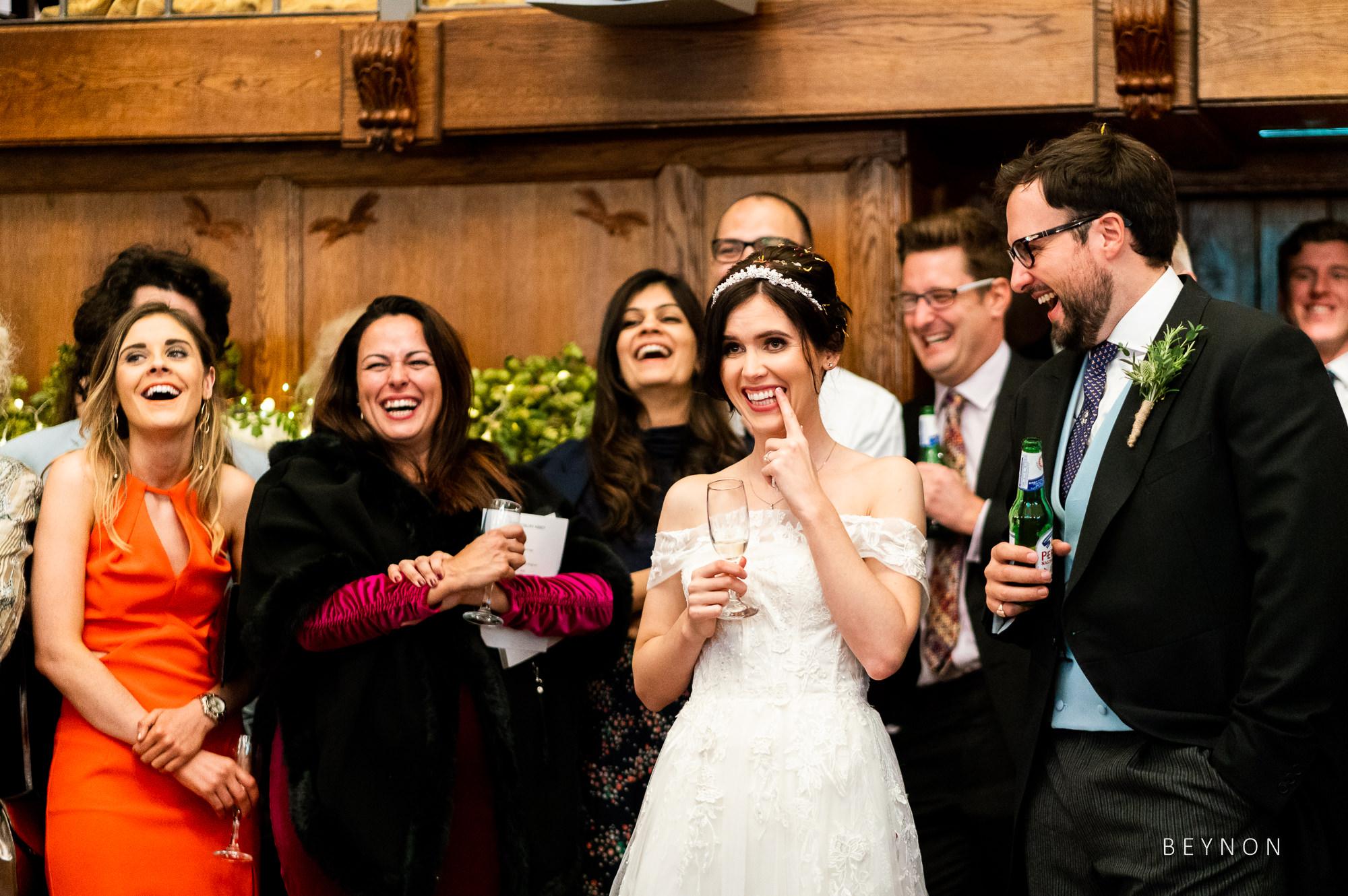Bride laughs at joke
