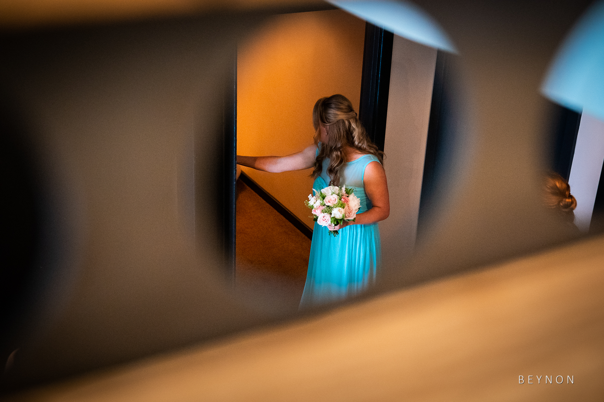 Bridesmaid heads upstairs to the ceremony