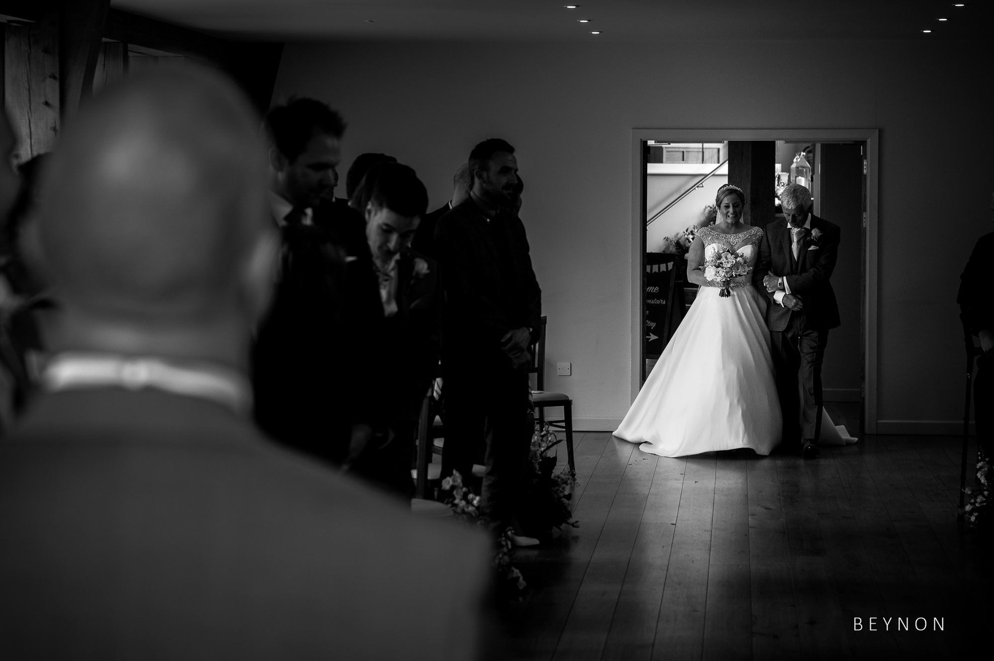 Black and White photo of the bride walking down the aisle