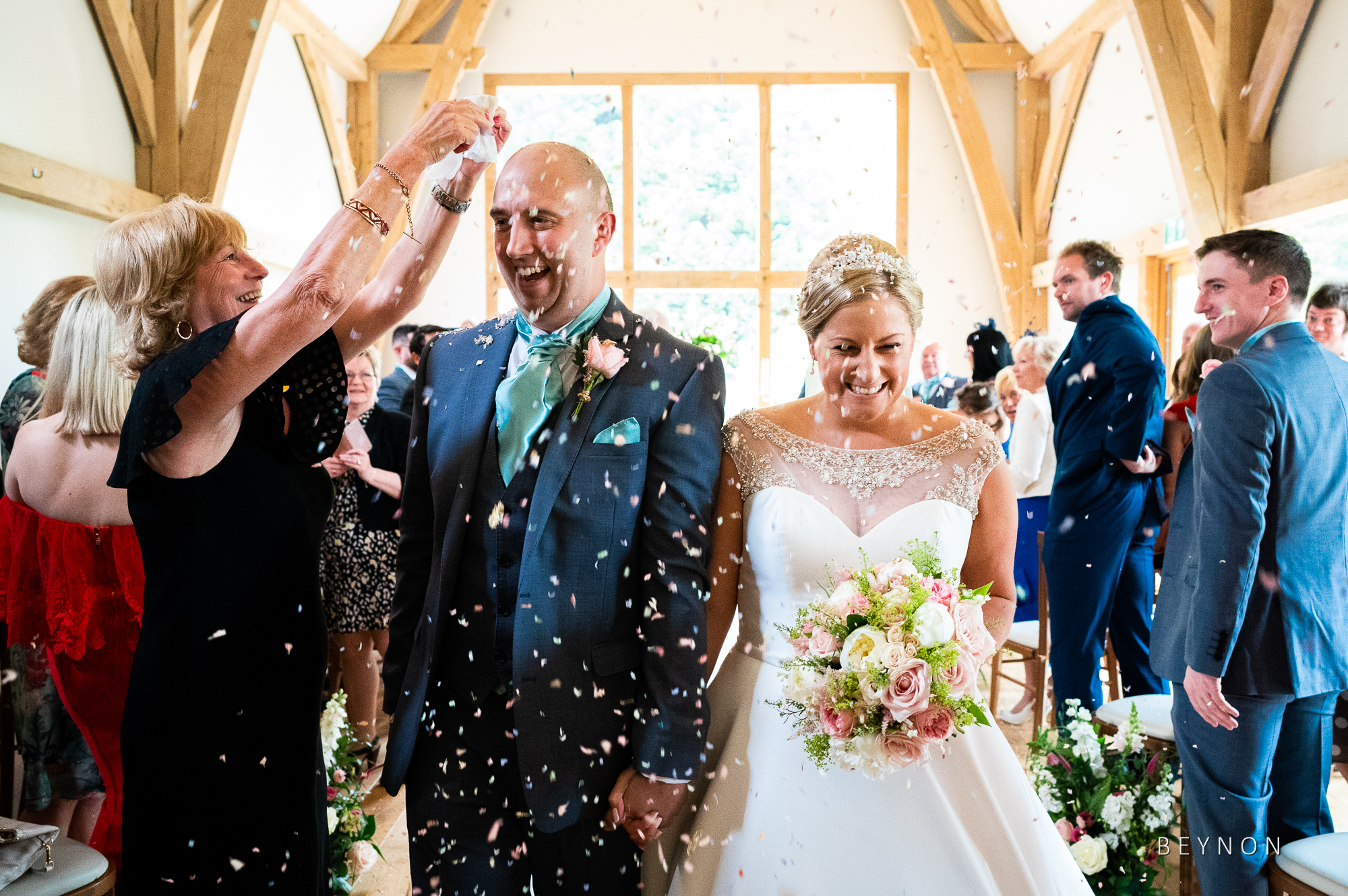 Confetti is tipped on the groom