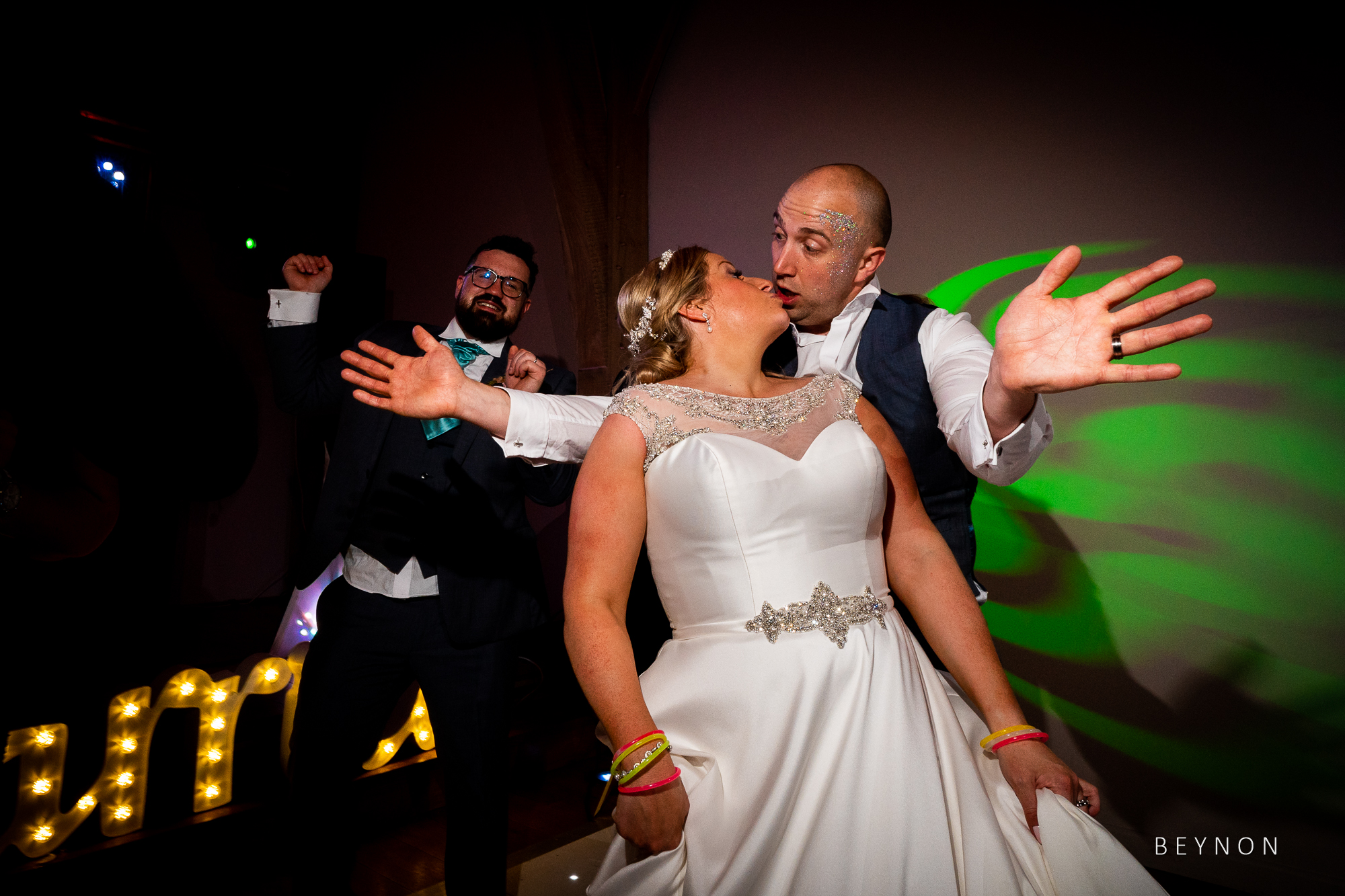 Bride and groom enjoy dancing together