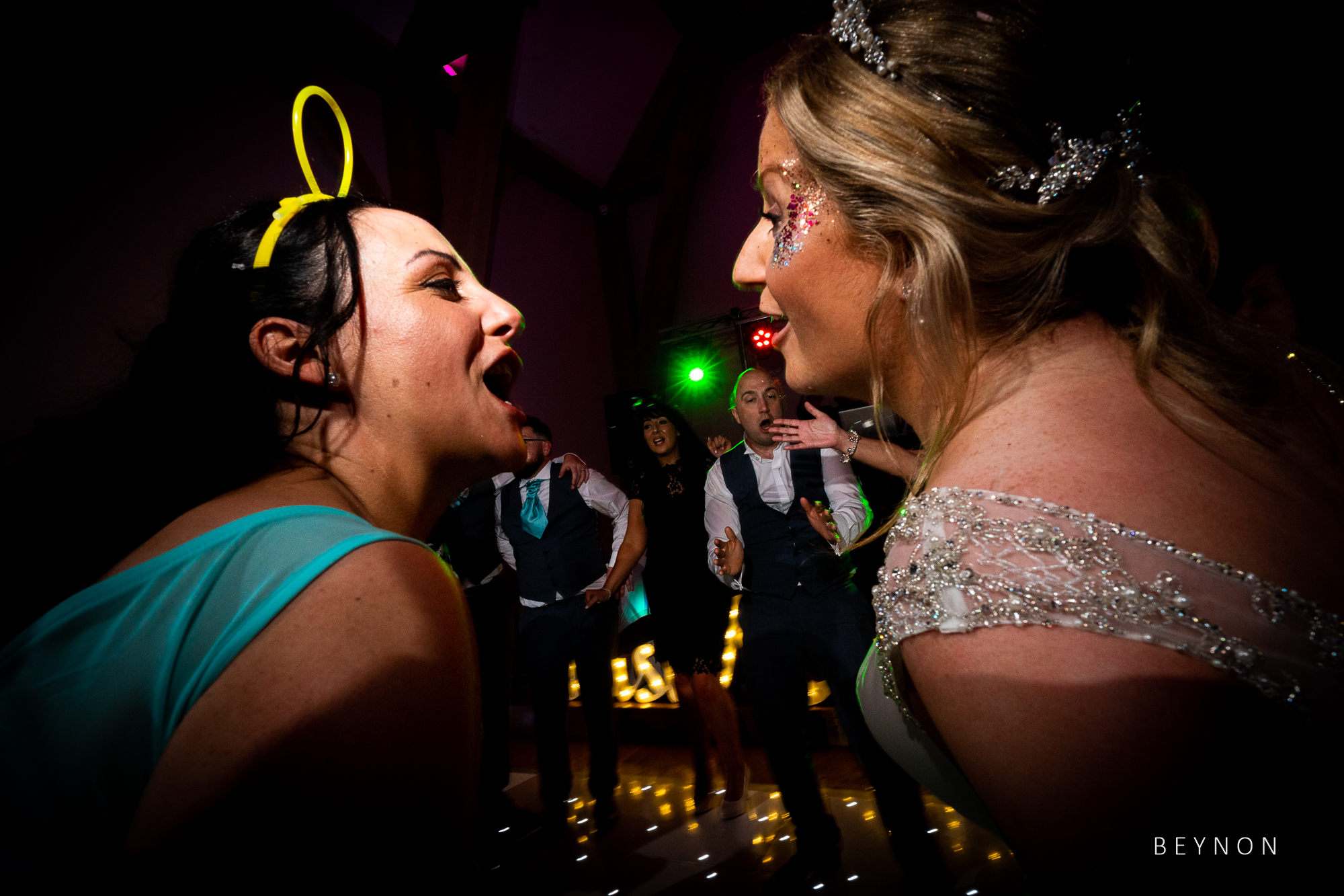 Bride and bridesmaid on dance floor