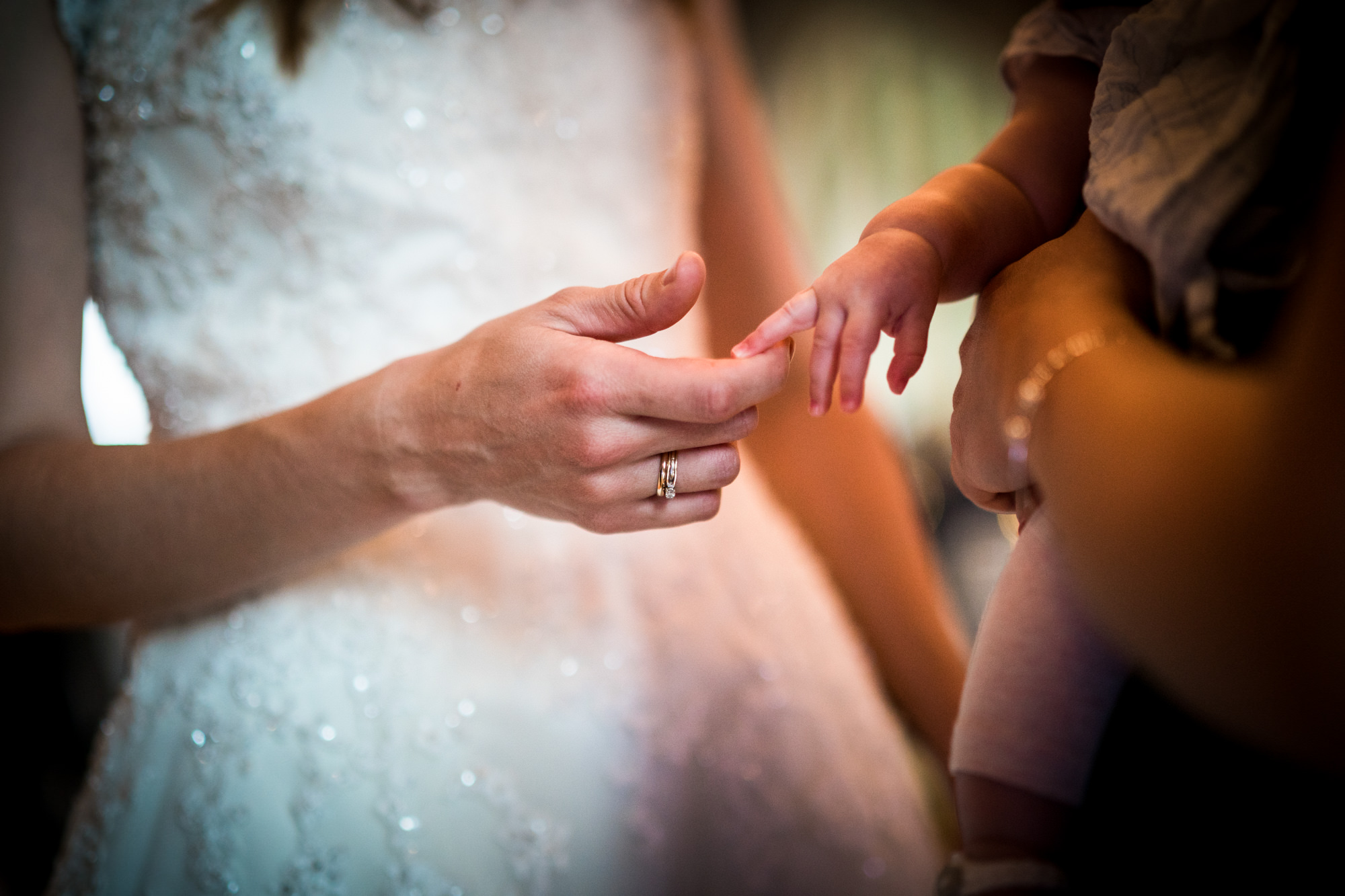 Small moments. Tight framing to highlight a lovely moment between bride and nephew.