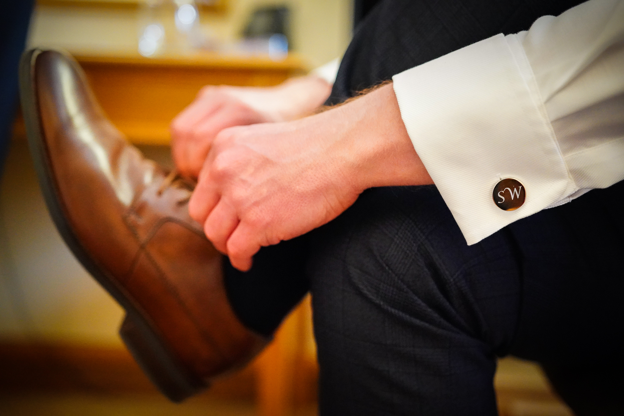 Personalised cufflinks, captured naturally during groom prep.