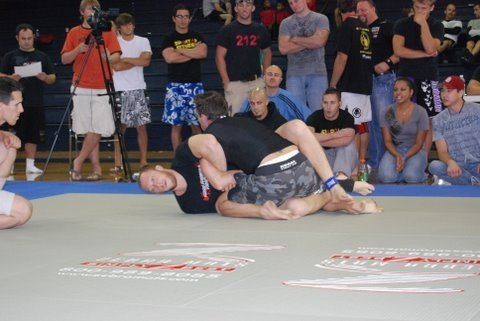 Author (top position) during first match of his first Brazilian Jiu-Jitsu tournament. This was just after he swept his opponent for two points to secure the win. Birmingham, AL circa 2006.