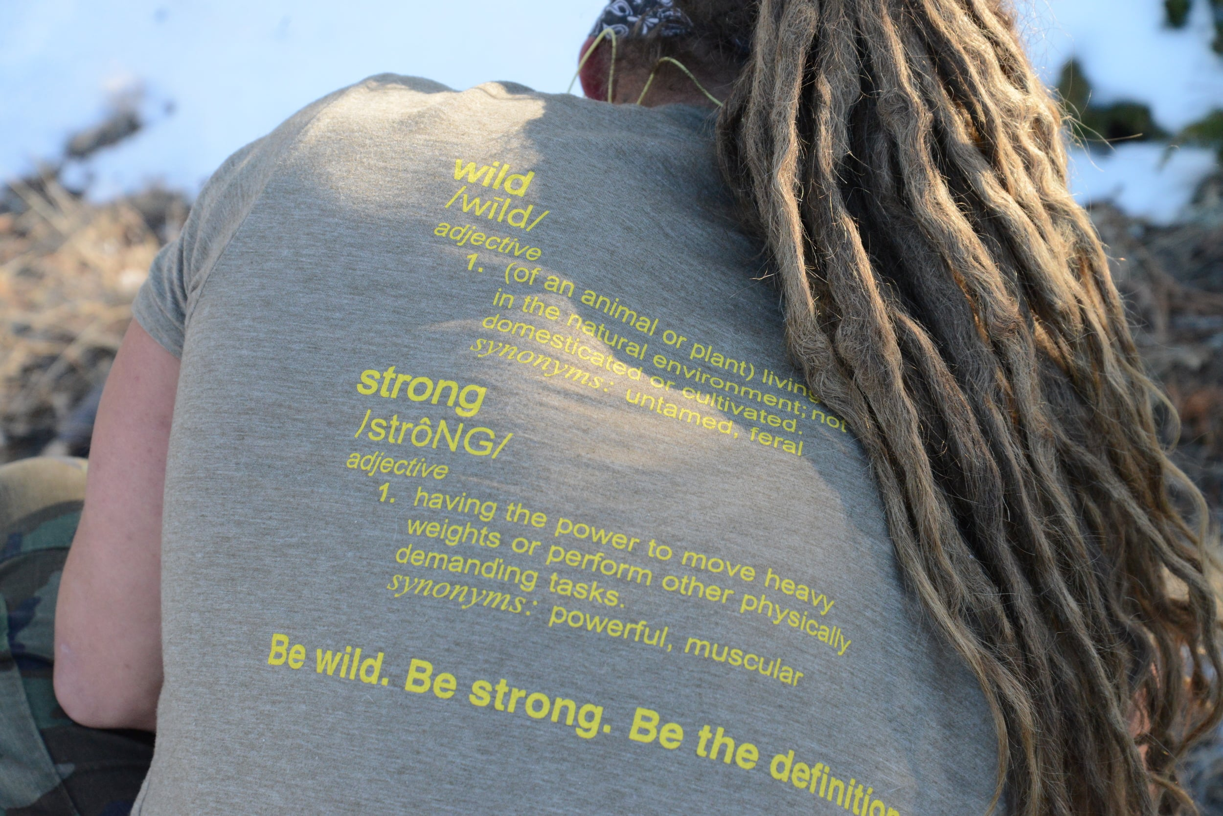 """Looking for a snatch-pun free shirt to hit your next workout in? Show your gym mates how wild/STRONG is defined. Our """"Definition"""" shirts are on sale NOW. Click the """"shop now"""" button below."""