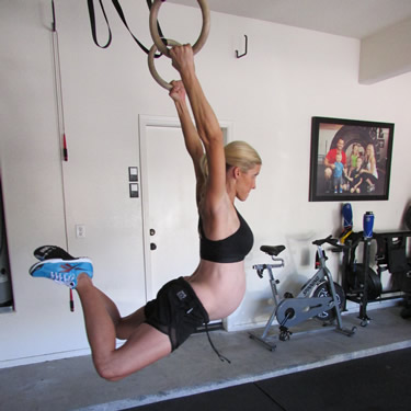 You may have your own ideas of whether or not pregnant women should CrossFit. She doesn't care what you think - and she is going to crush you in today's workout. Deal with it.