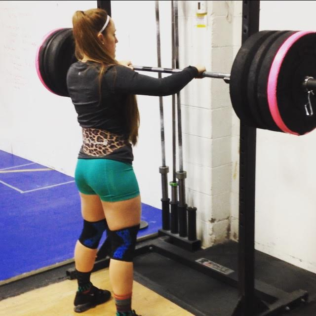 wild/STRONG's biggest supporter testing her 1rm squat as we prepare for the Bumper Plate Date at Big Thompson Crossfit in Loveland, CO.