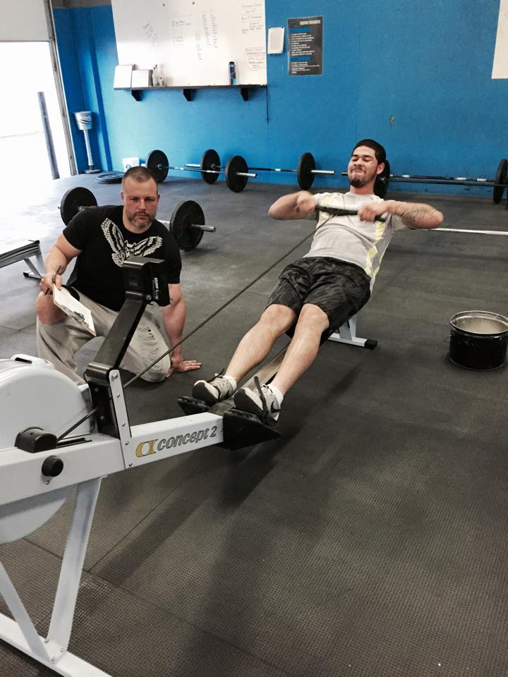 Josh coached at CrossFit Helix for more than 3 years - here he judges one of his athletes during a CrossFit Open workout.