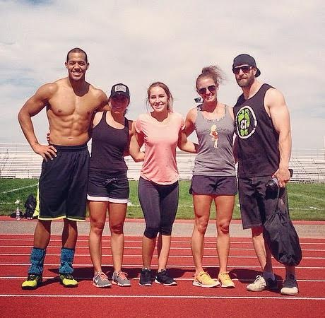 It wasn't always like this. Bennett (far left) with CrossFit 307 owner Jeremy Davis (far right) before Bennett's departure from 307 in 2014.