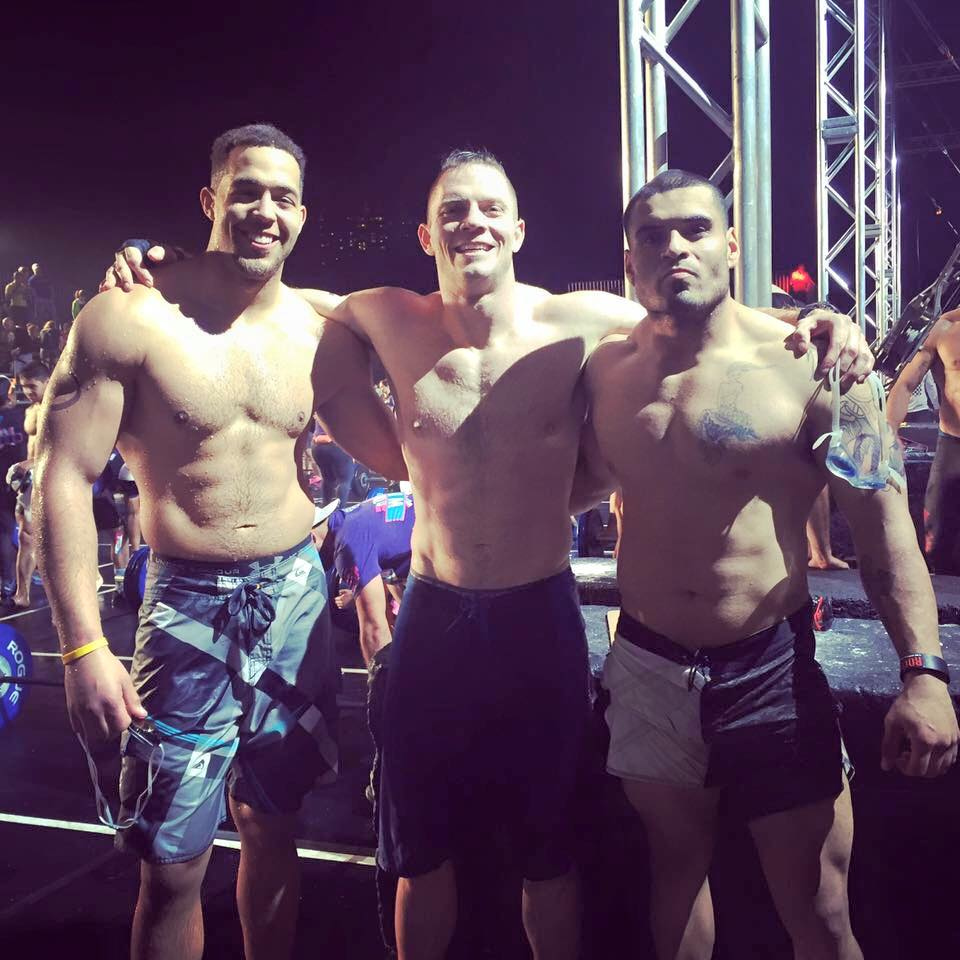 Bennett, left, with Guill, center at last year's Wodapalooza in Miami, FL.