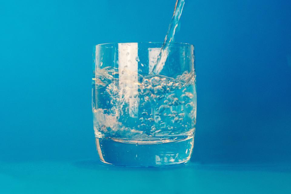 water glass half full optimism