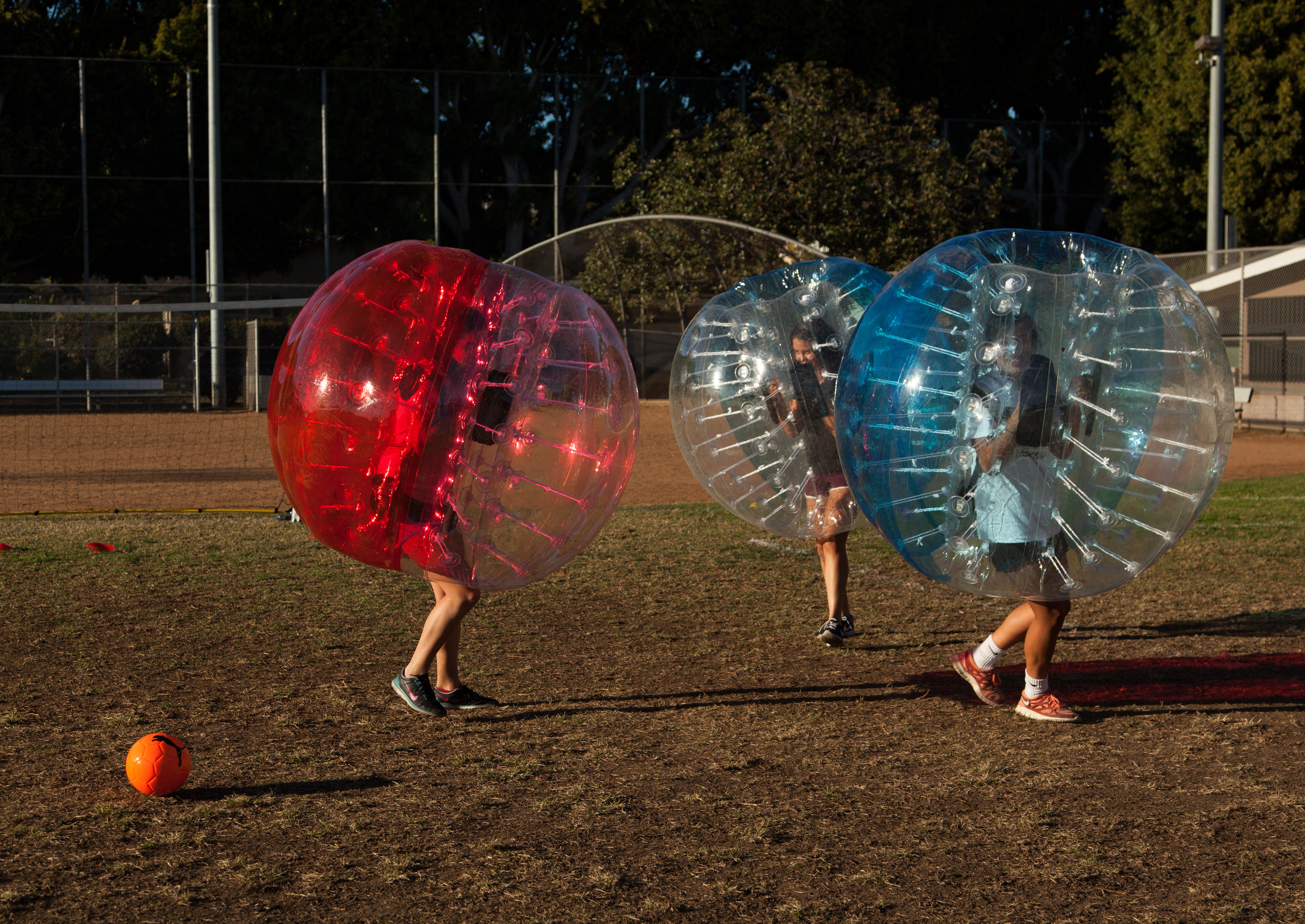 find the ball during a game at a bubble soccer party in westlake village park