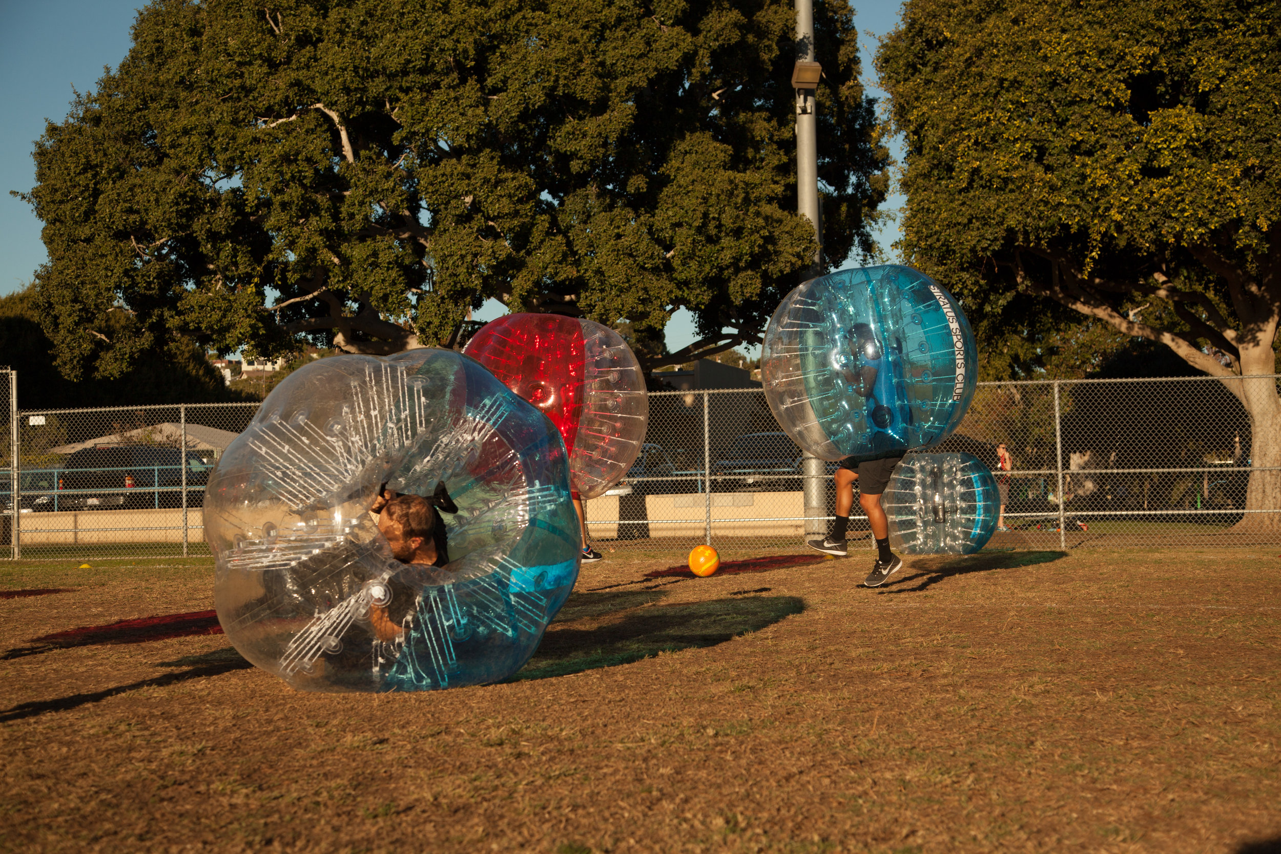 bubble soccer knock down games are fun at park in Glendale