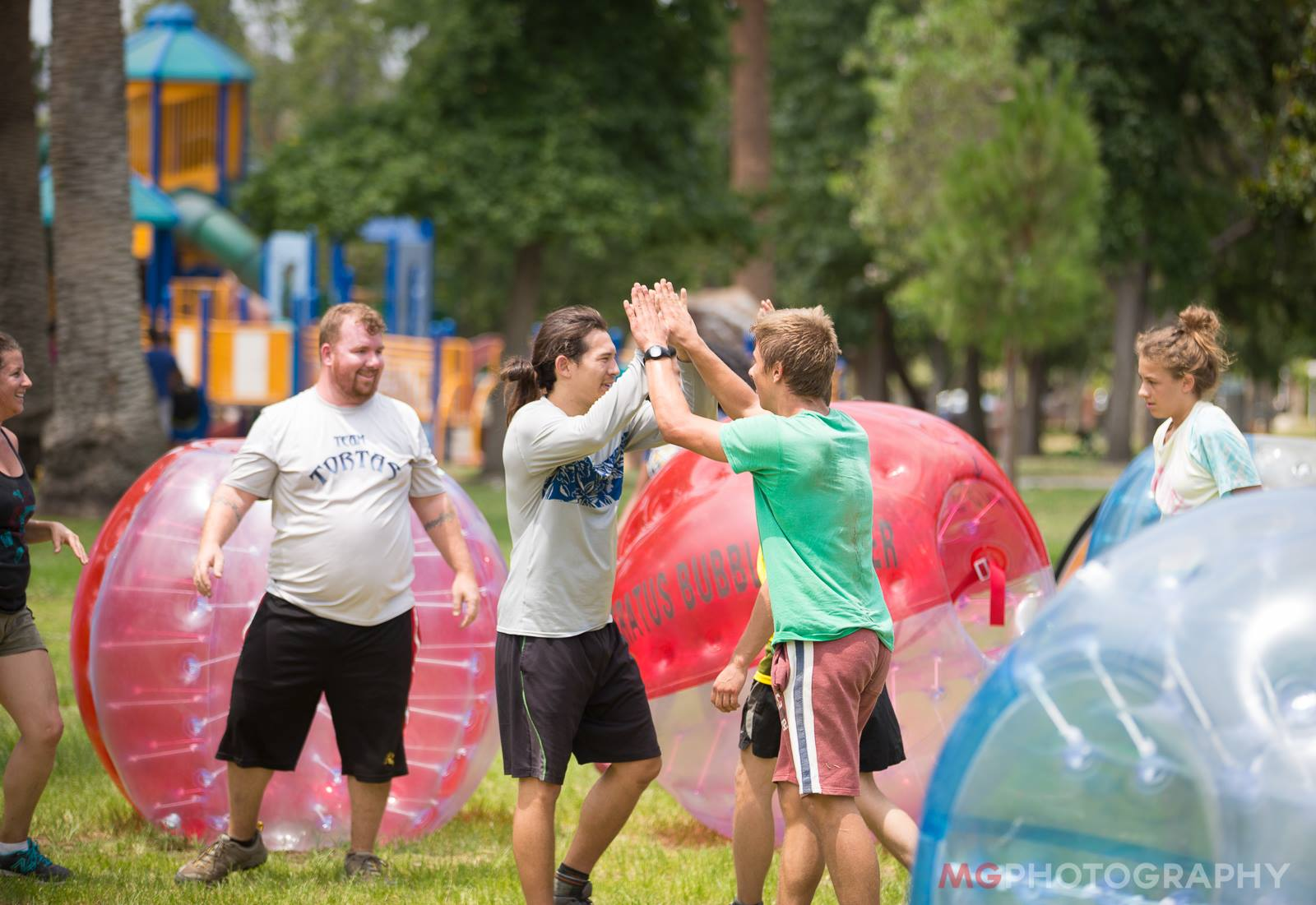 Celebration after a good game of bubble soccer a beginners guide to knockerball