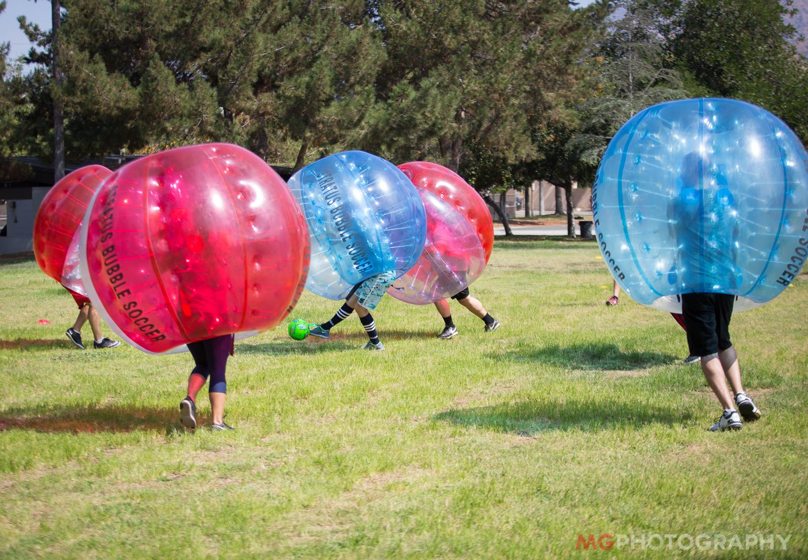 What are those giant inflatable things at the park that people are running around in? It's called bubble soccer