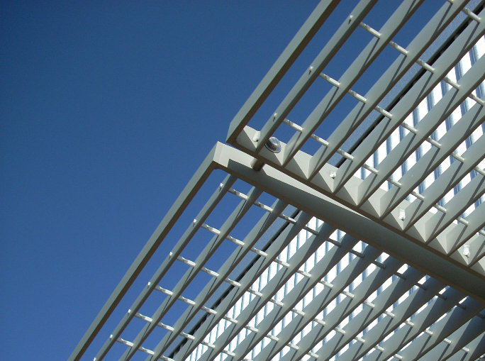 Exterior solar shading devices are fabricated from industrial bar grating.
