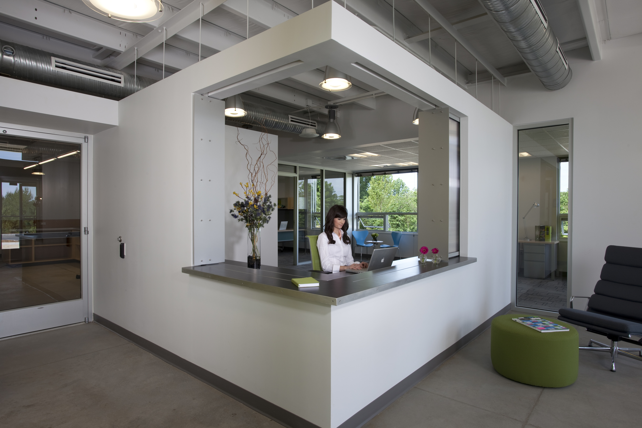 Inside, simple materials enliven the exposed structure of the pre-engineered metal building.