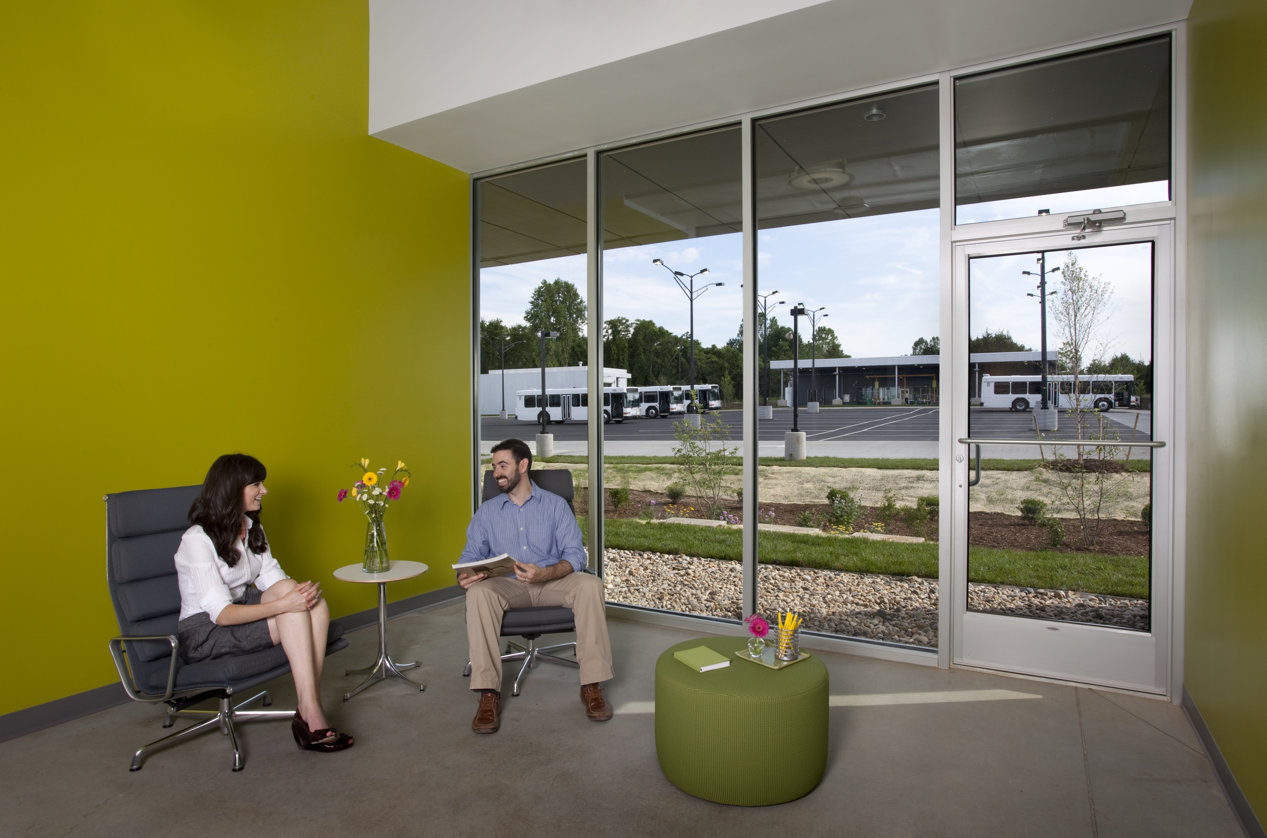 From the staff lounge, employees enjoy simultaneous views of the butterfly garden and the transit vehicle parking area.