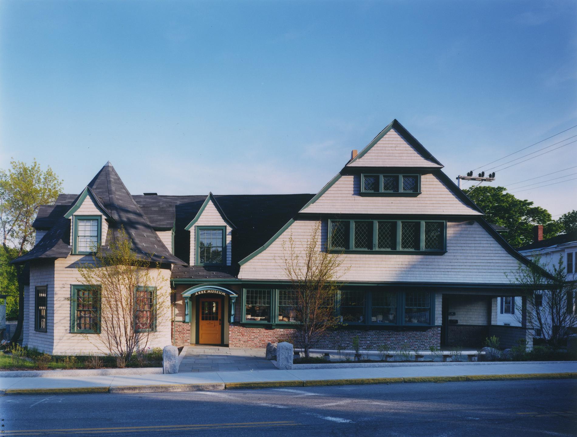 The restored shingle-style façade facing Mount Desert Street, a half block from downtown Bar Harbor's Village Green