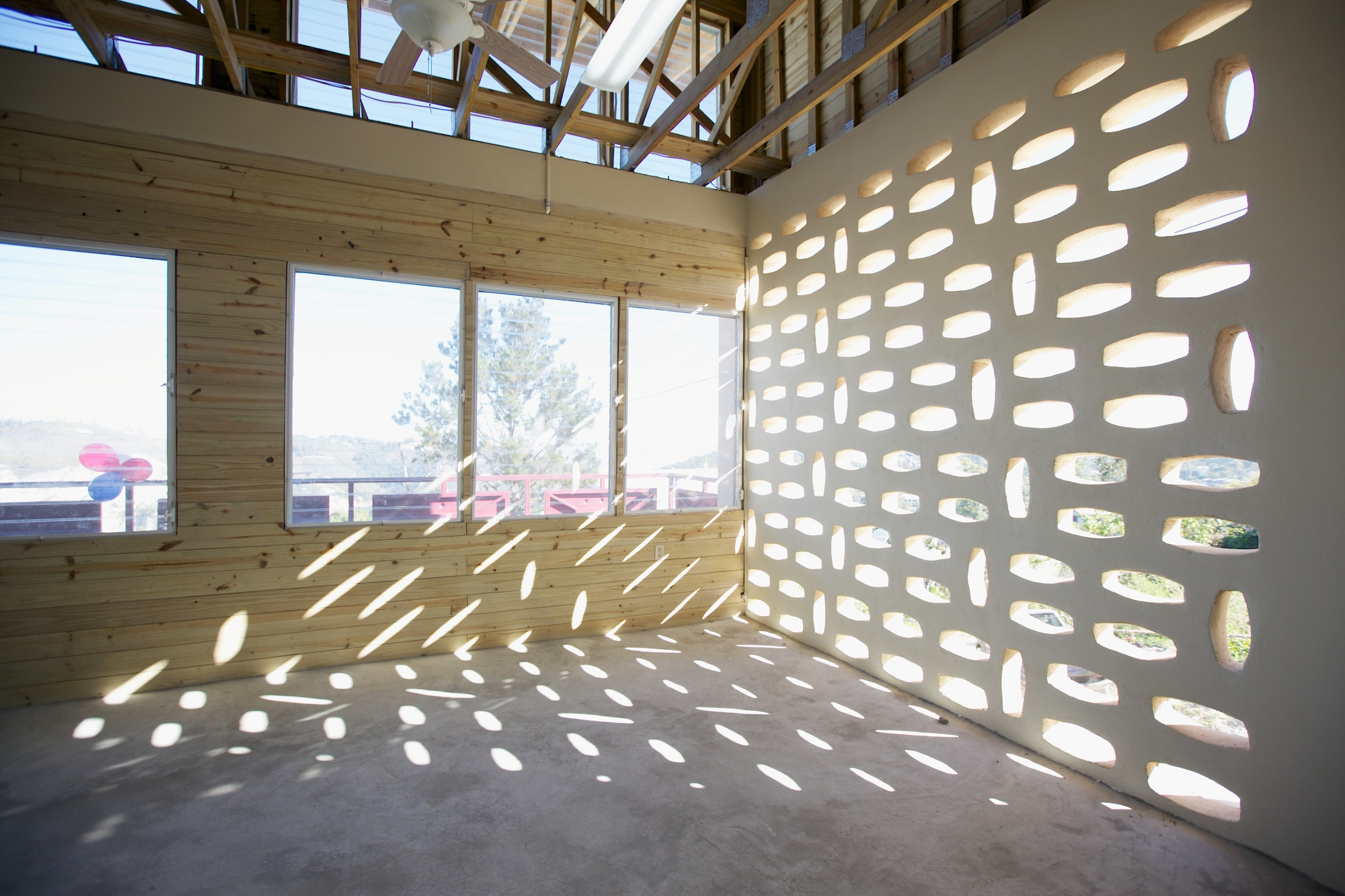 Locally-cast masonry units provide dappled sunlight to the institute's interior spaces.