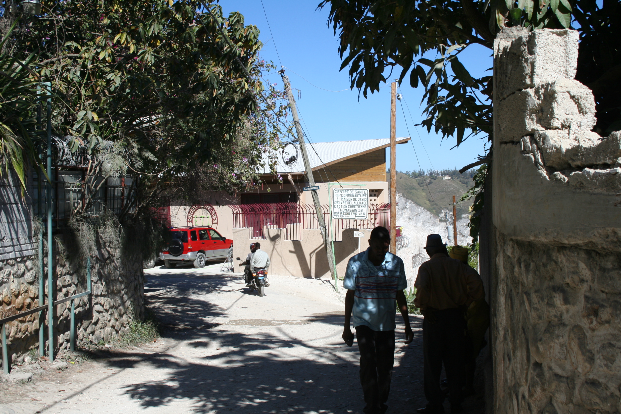 The facility is situated on a ridgetop above Port-au-Prince and accessed through narrow winding lanes.