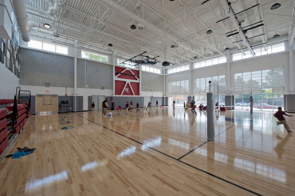 High-bay LED lights are rarely used in the shared use gymnasium which is naturally daylit by clerestories and well-shaded south-facing glazing.