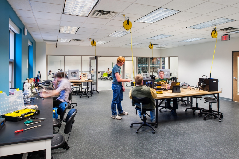 Overhead power reels in the new student-run Maker Space support reconfiguration of the space and help maintain a safe and tidy work environment.